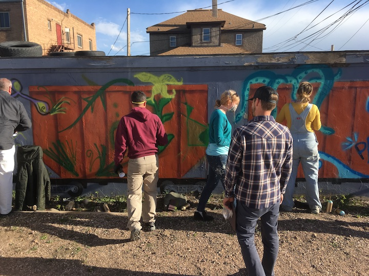Artist Dan Toro leads a spray paint workshop this spring to get the wall started off.
