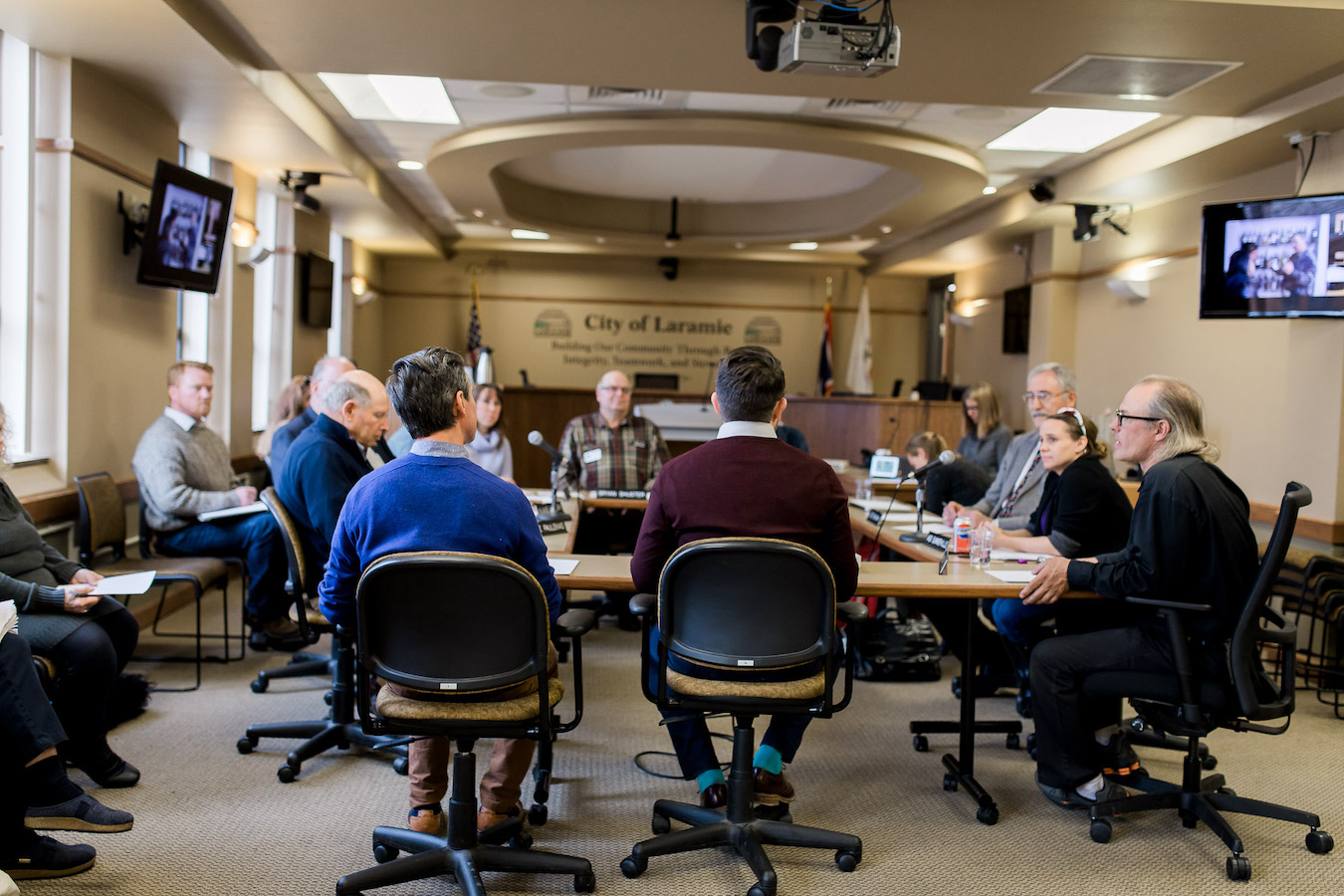 City Council patiently listens as the artists explain this cognitive memory exercise process. Photo credit Megan Lee Photography