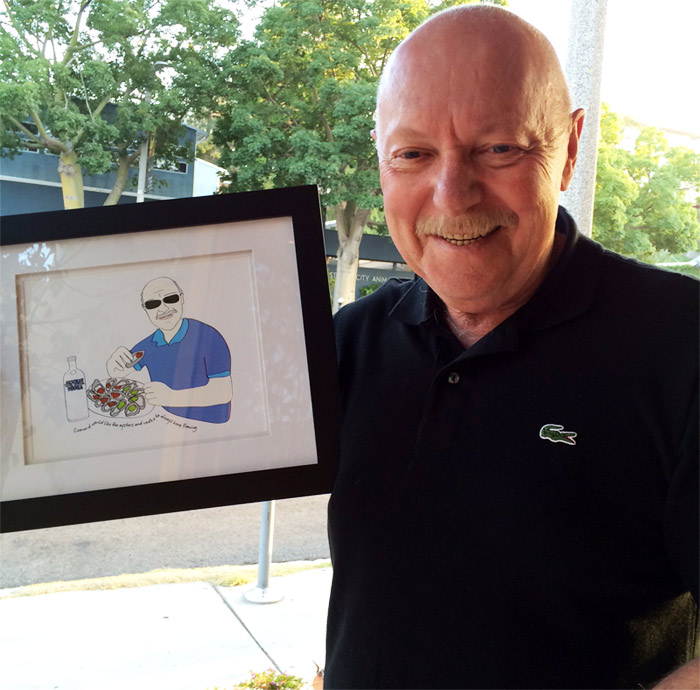 My dad, Leonard, getting a kick out of his illustration!