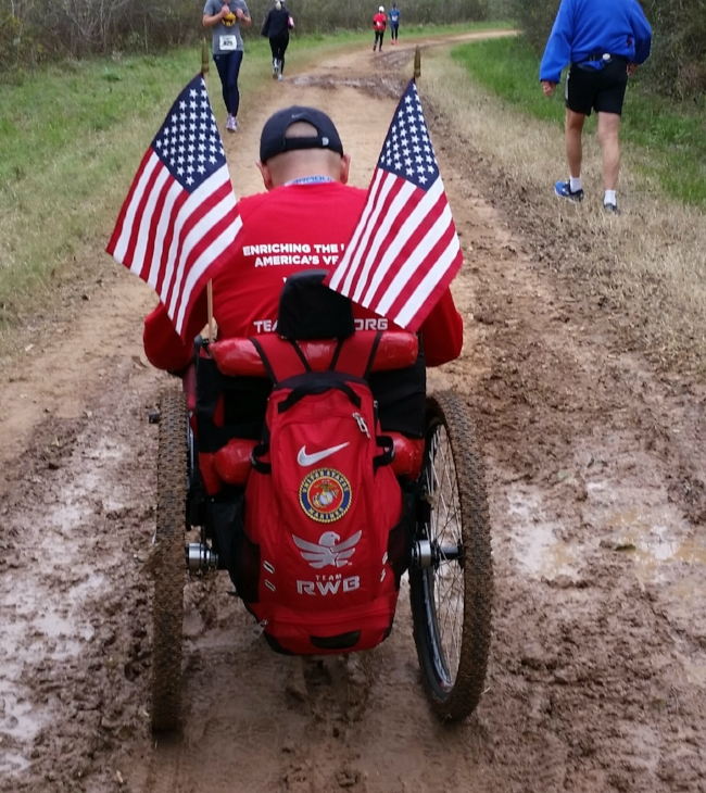 Bennie Jose Perez tackles a muddy trail to complete the Brazos Bend 100 Marathon in his  GRIT Freedom Chair.