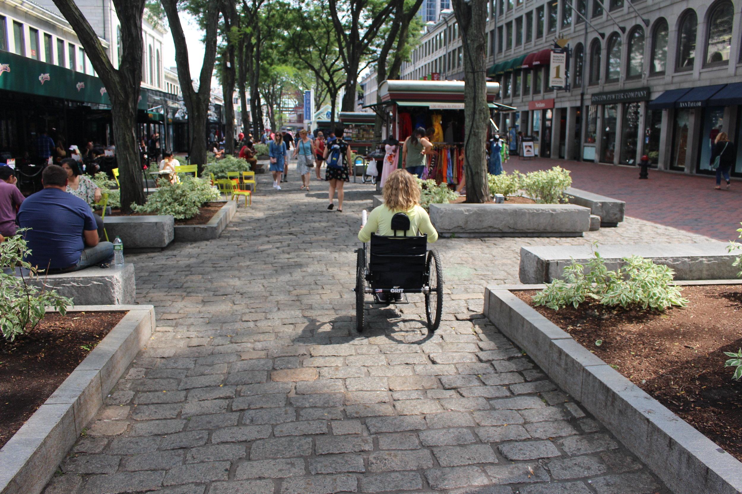 Traversing the cobblestones near Quincy Market.