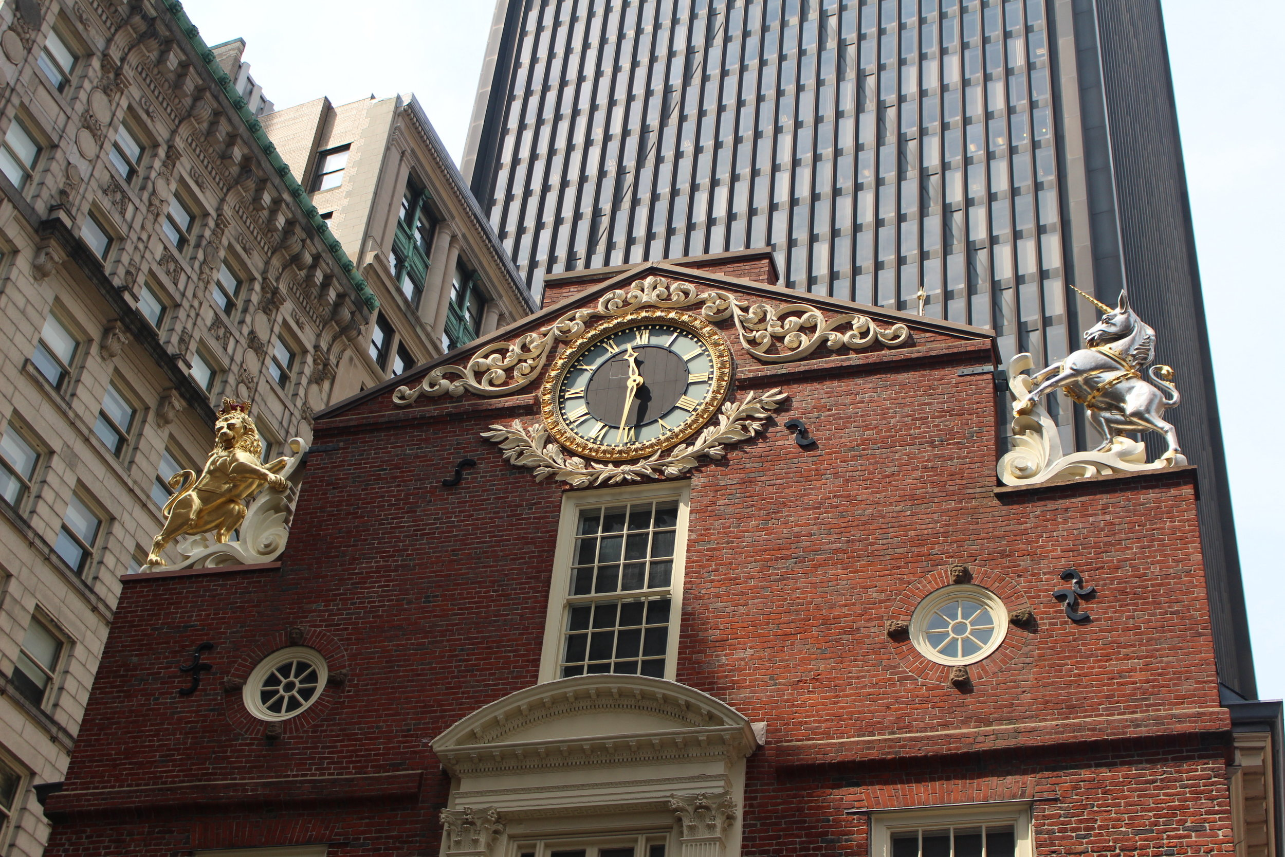 The golden lion with the crown and the silver unicorn on top of the Old State House.