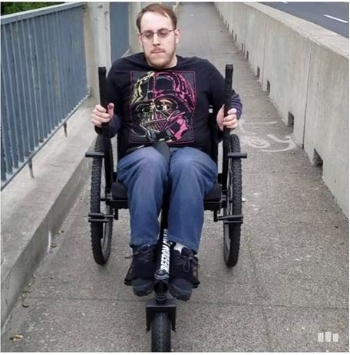 Brett out and about testing out the GRIT freedom chair on some uneven pavement.