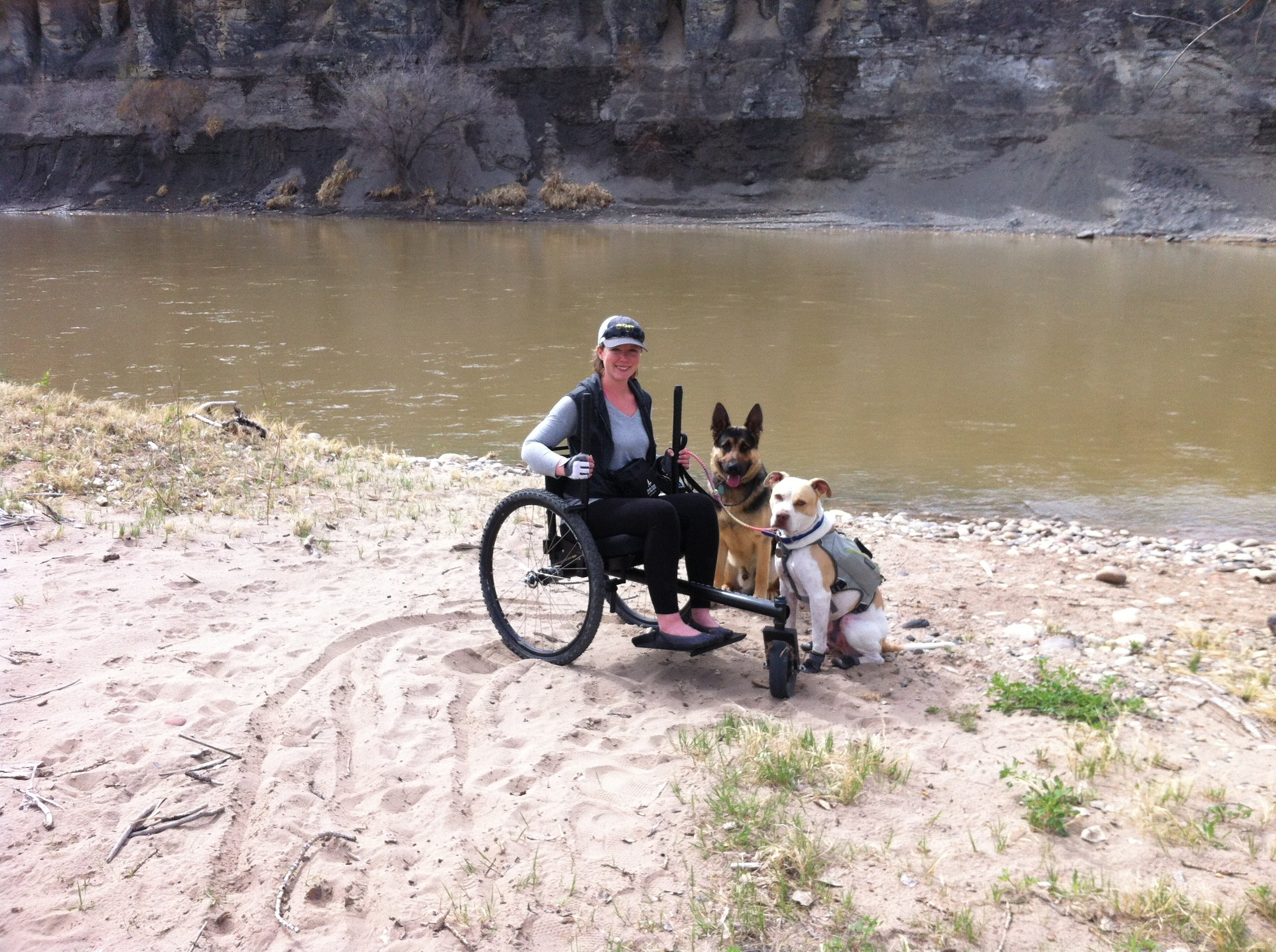 Exploring along the Colorado River in my GRIT Freedom Chair accompanied by German Shepherd Trae and my Service Dog, Cash!