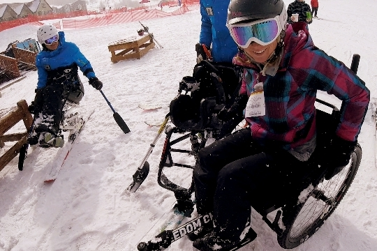 At Park City Mountain Resort, transferring from my Monoski to my GRIT Freedom Chair!