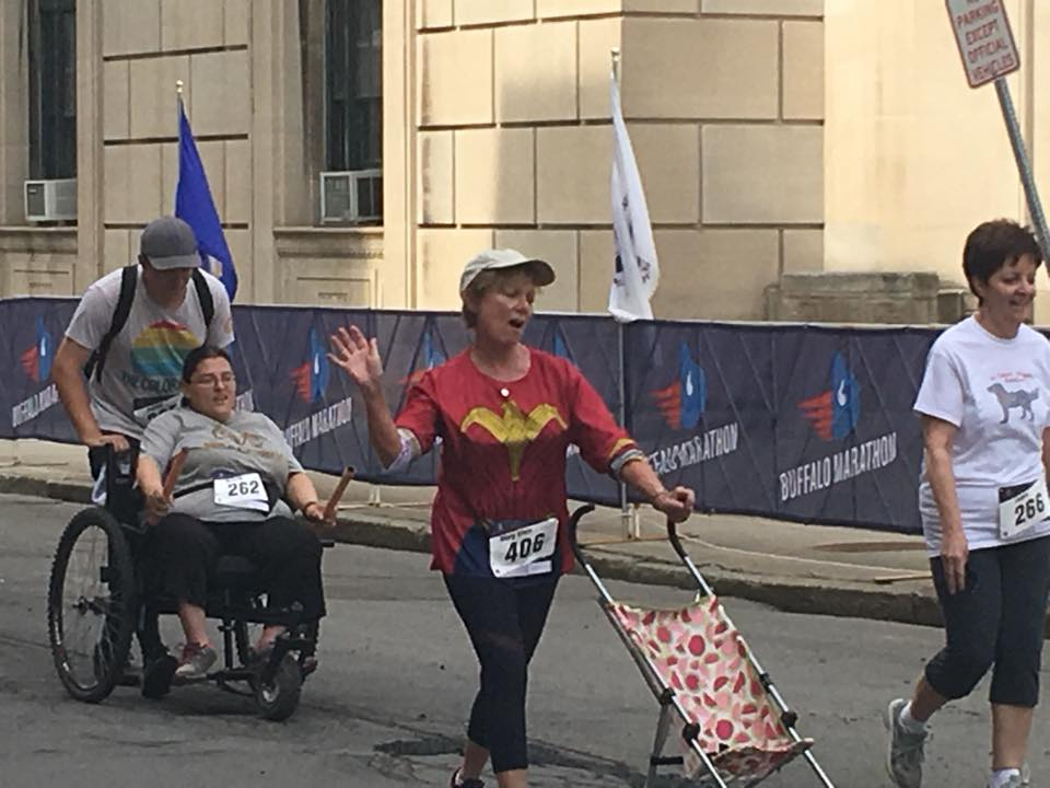 """""""I completed a 5K as part of the Buffalo Marathon with my son, Joshua, and my always-amazing Freedom Chair. I have cerebral palsy, so without the Freedom Chair there is no way I could have walked the entire course. The Freedom Chair has allowed me to do 5Ks and be successful. For me, it isn't about what place I come in: It is about finishing. I love to race and find it so exciting. I am a FINISHER because that is HOWE I do it!"""" - Brandy Howe"""