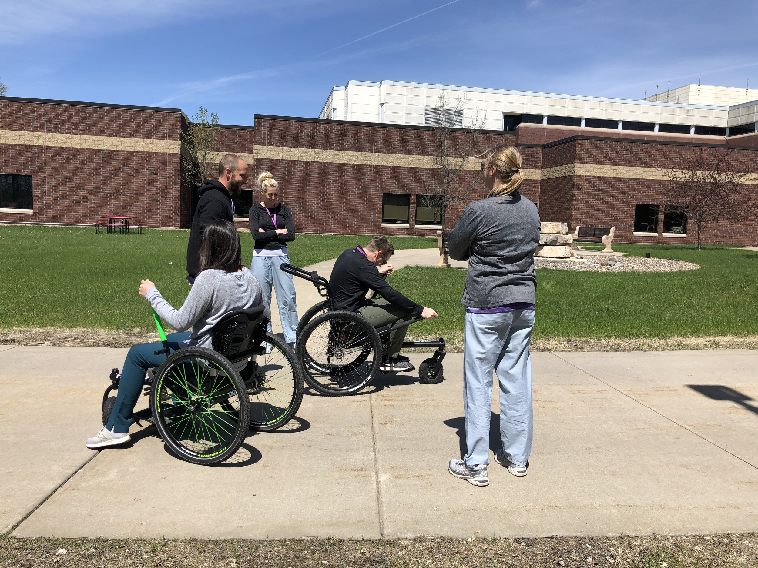 Minneapolis VA Health Care System's Physical and Occupational Therapists trying the Freedom Chair