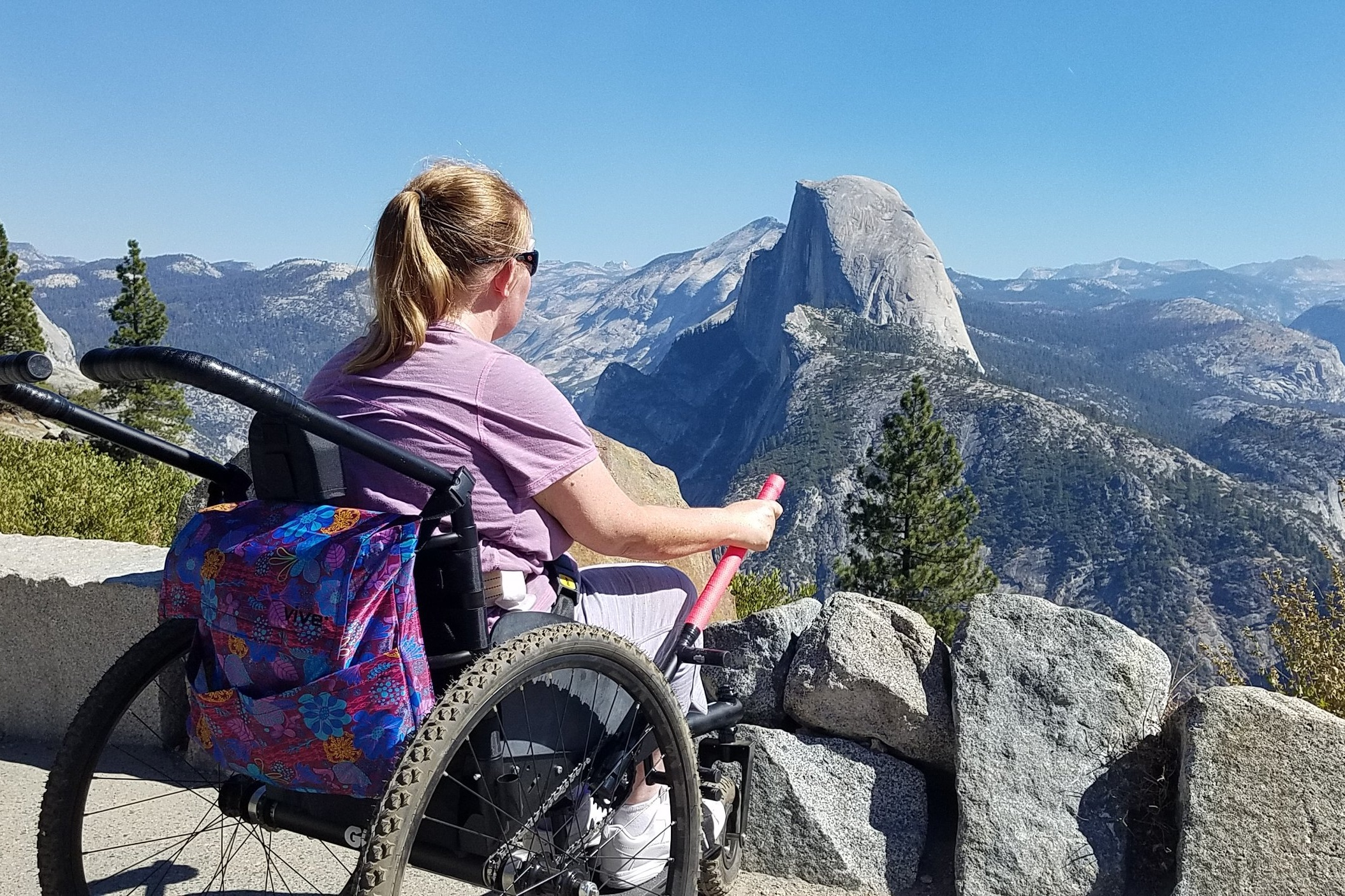 The Freedom Chair is helping me develop upper body strength. It was a beautiful, warm, sunny day at Glacier Point (7,214' elevation).    —  Shannon , at Glacier Point in Yosemite National Park