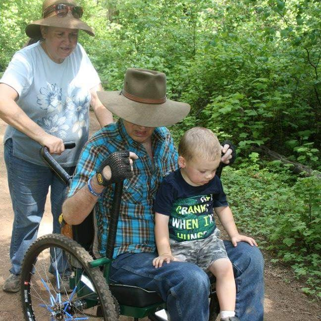 My trail buddy is my wife Kathy. We go together on whatever adventures we decide to do. She is a great help in those rough places where I might need a little extra push. That is my grandson hitching a ride. The Freedom Chair has given me that independence to be able to get out in the outdoors once again.     —Eric