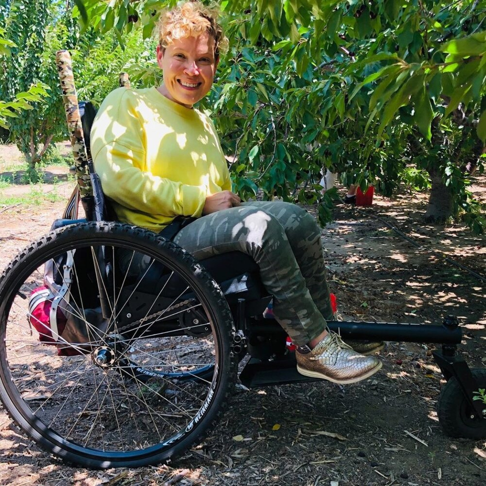 """Today I got outside with my GRIT Freedom Chair and did an activity that was a total dream come true for a girl living in the city. I picked my own cherries, my favorite fruit. My manual chair would have never made it through the orchard without a fight.""   —Donna"