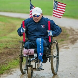 """Bennie is an eight-year Marine Corps veteran (1991-1999) and above-the-knee amputee. He faces daily challenges with severe phantom pain, neuropathic pain, and muscle spasms that prevent him from wearing a prosthesis. An aspiring Paralympian, Bennie has used his Freedom Chair in multiple races and ultramarathons.   """" Without the Freedom Chair, I couldn't experience what most trail runners feel after conquering trail distances—[from] half marathons on up to 100 miles.""""     Read more about Bennie"""