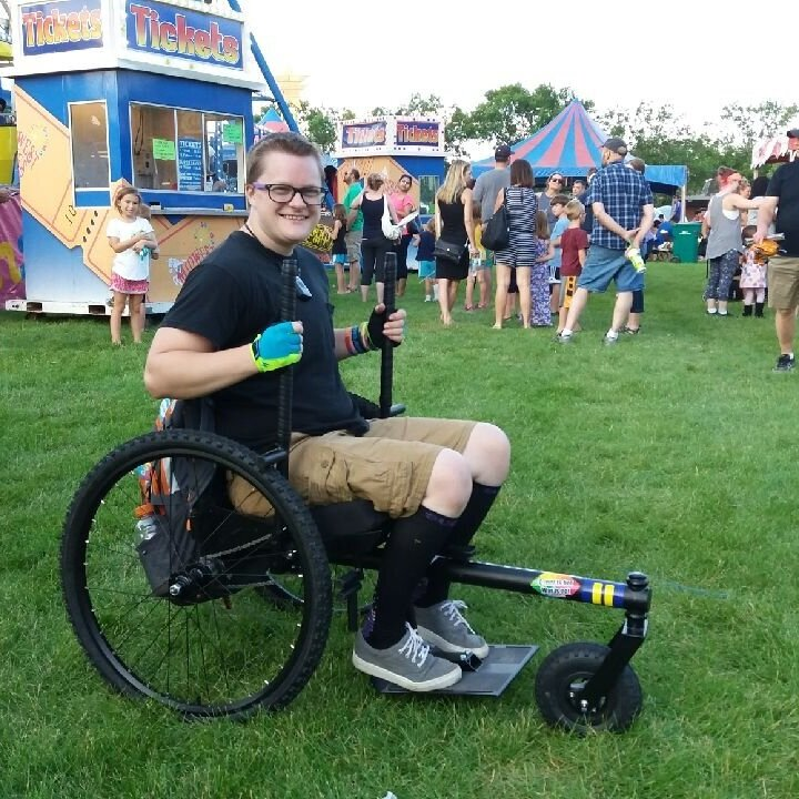 """""""I was able to go to my local Fourth of July Festival with my mom in my GRIT Freedom Chair! It was in a grassy field behind the elementary school and I can't go on grass in my standard manual chair, so it was really fun to be able to experience it in my Freedom Chair.""""    —Hayden, Postural Orthostatic Tachycardia Syndrome (POTS)"""
