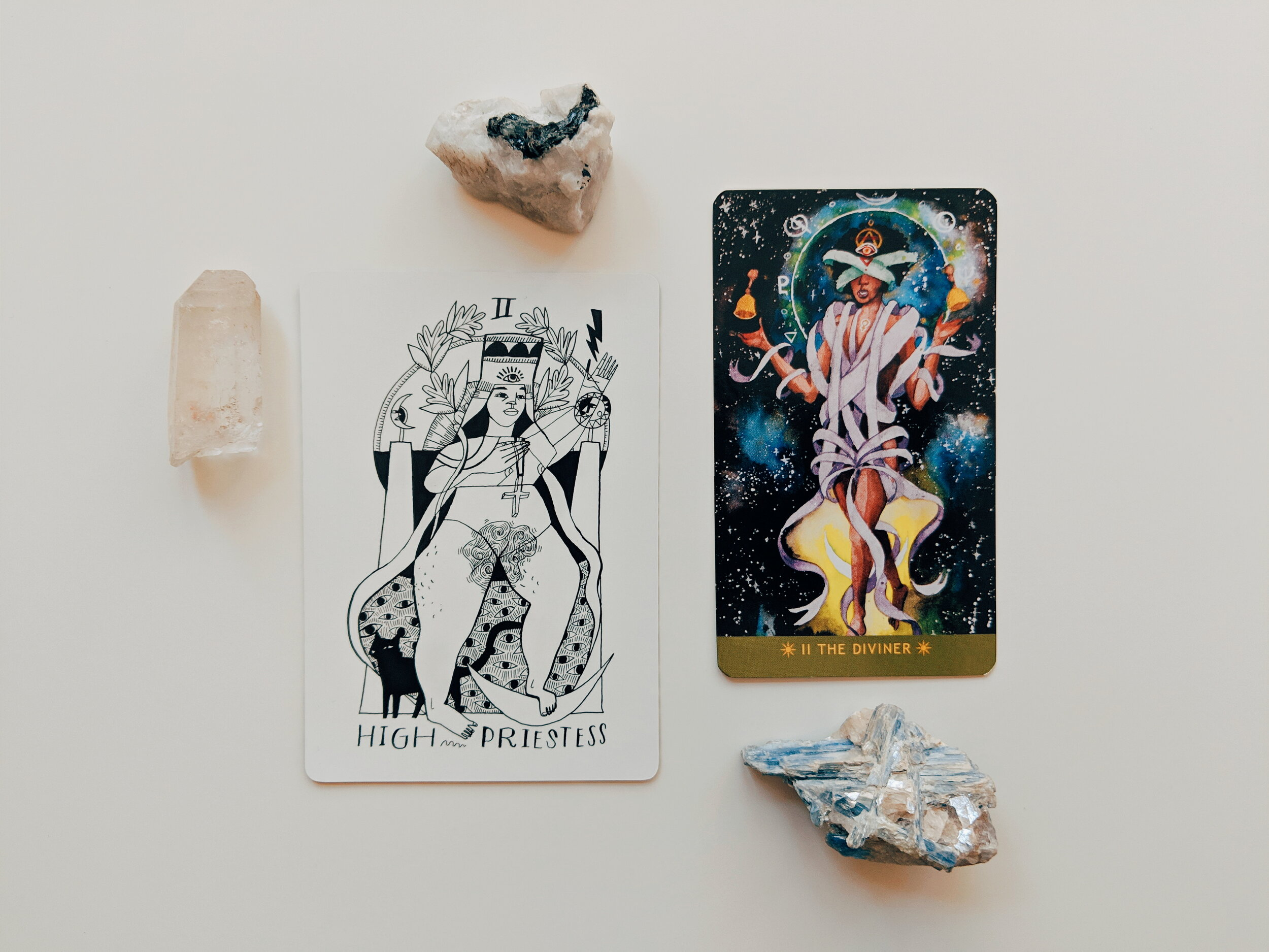 Decks shown are the  Many Queens Tarot  and the  Numinous Tarot