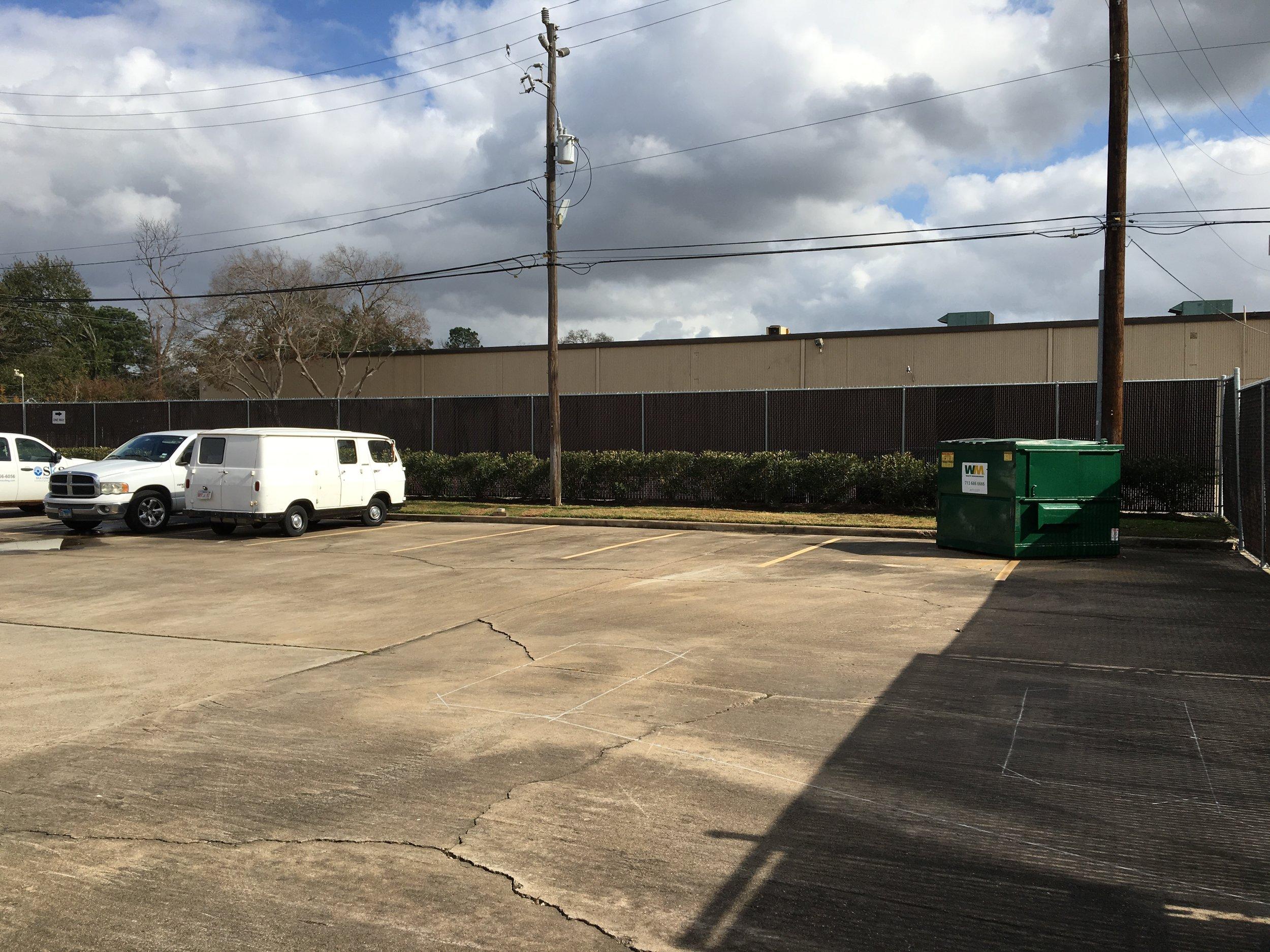 Back parking lot dumpster