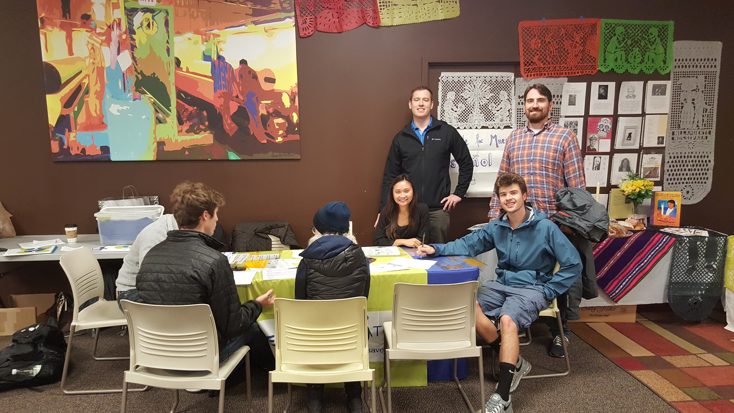 Tate educating a potential donor. Back right: (left) Van Nguyen, Justin Thompson, Travis Oulette, Doug Woods (right)