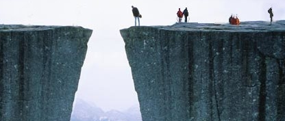 Photo of a person looking down on a cliff