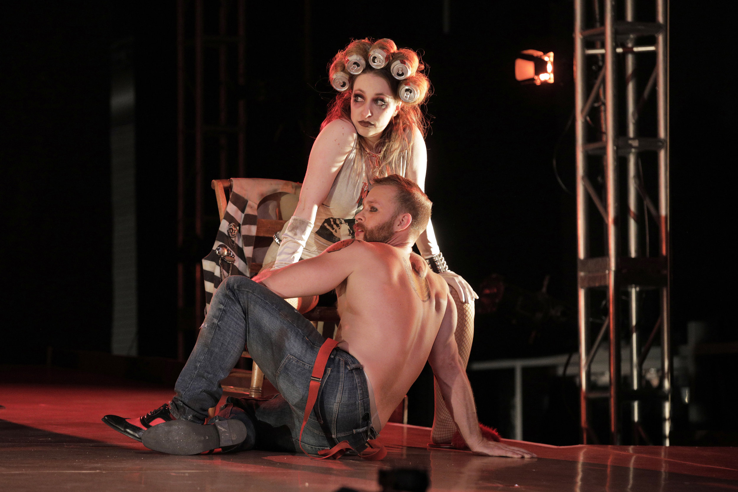 A prostitute (Leslie Katter) and Macheath (Derek Chester) in West Edge Opera's production of The Threepenny Opera