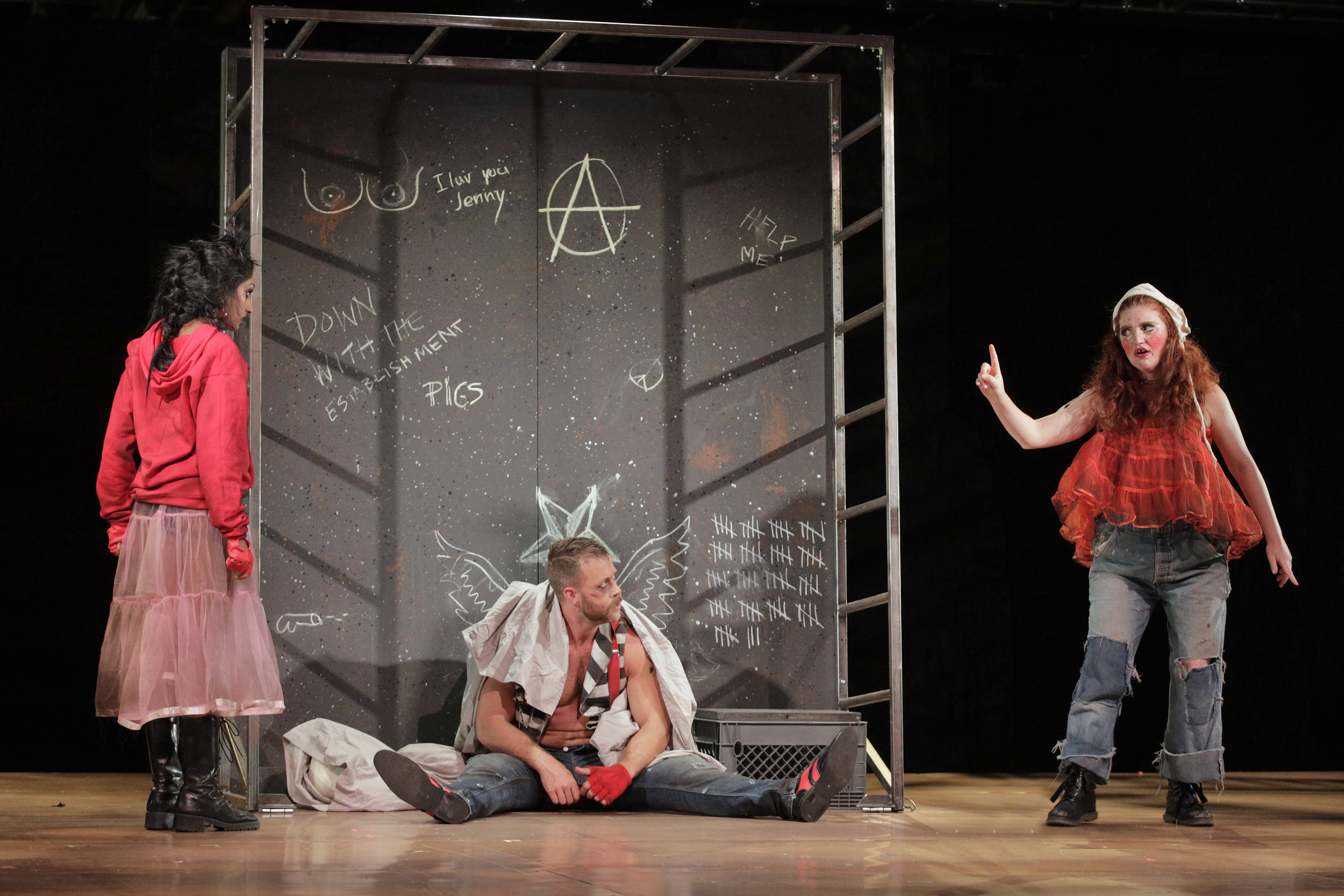 Polly Peachum (Maya Kherani), Macheath (Derek Chester), and Lucy Brown (Erin O'Meally) in West Edge Opera's production of The Threepenny Opera