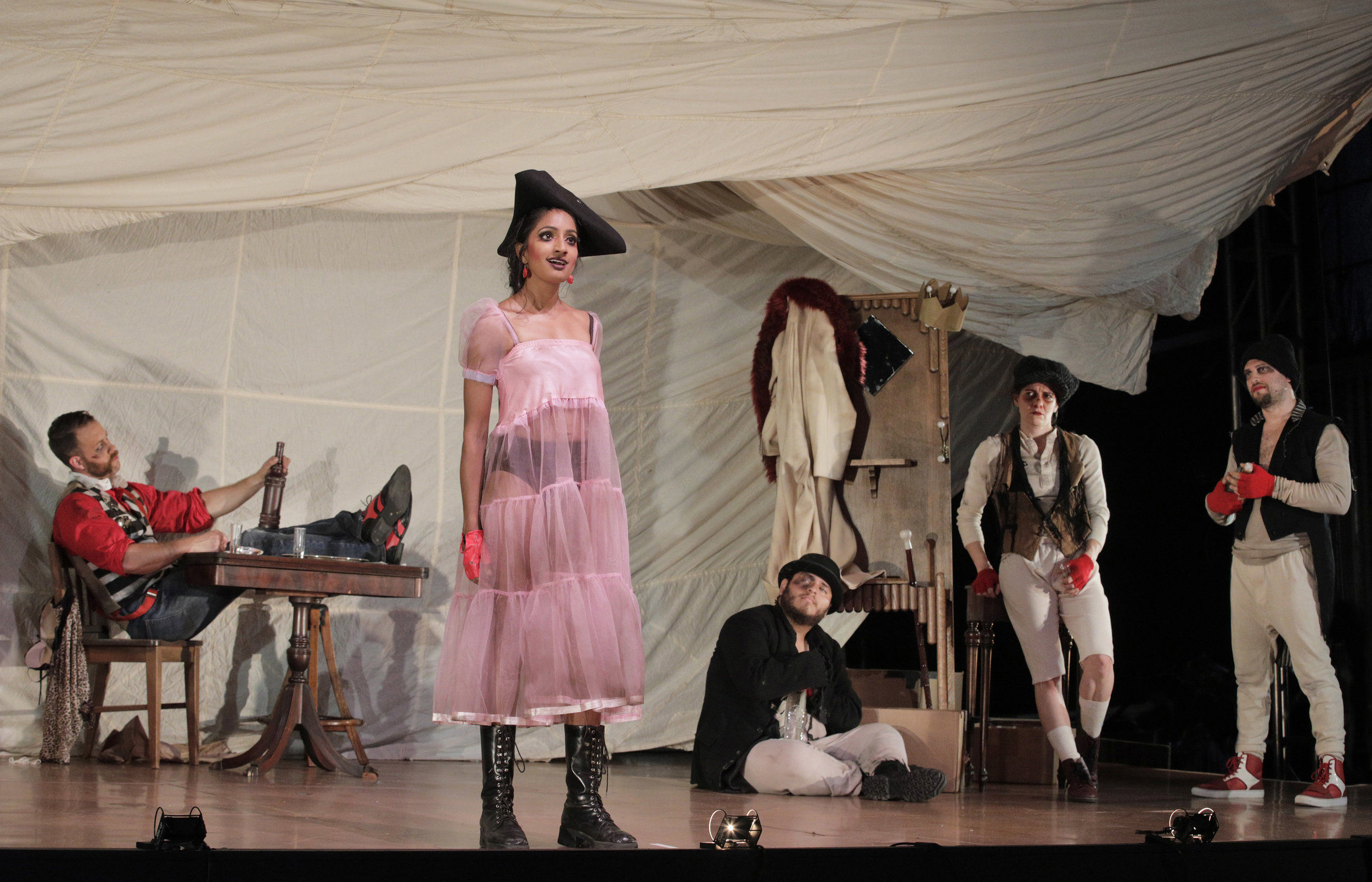 "Polly Peachum (Maya Kherani) sings ""Pirate Jenny"" in West Edge Opera's production of The Threepenny Opera"