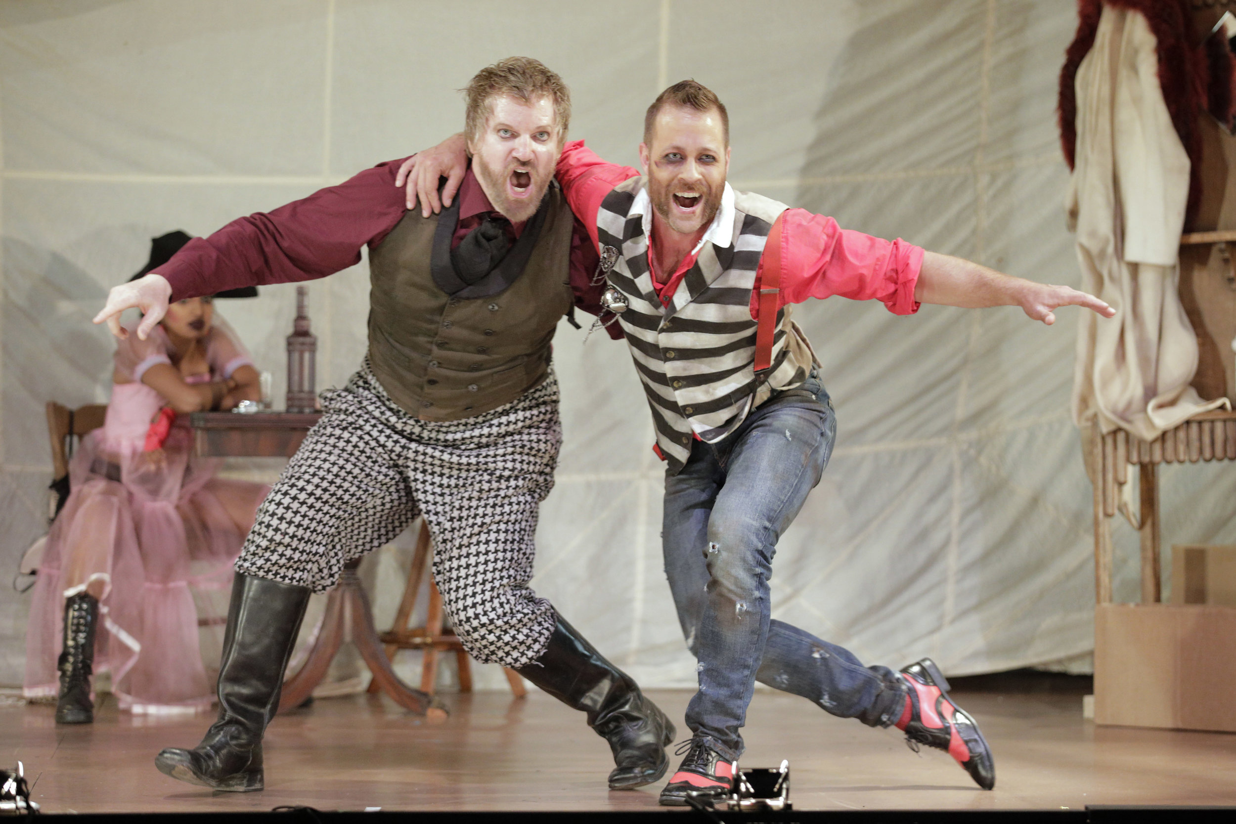 "Tiger Brown (Robert Stafford) and Macheath (Derek Chester) sing ""The Cannon Song"" in West Edge Opera's production of The Threepenny Opera"