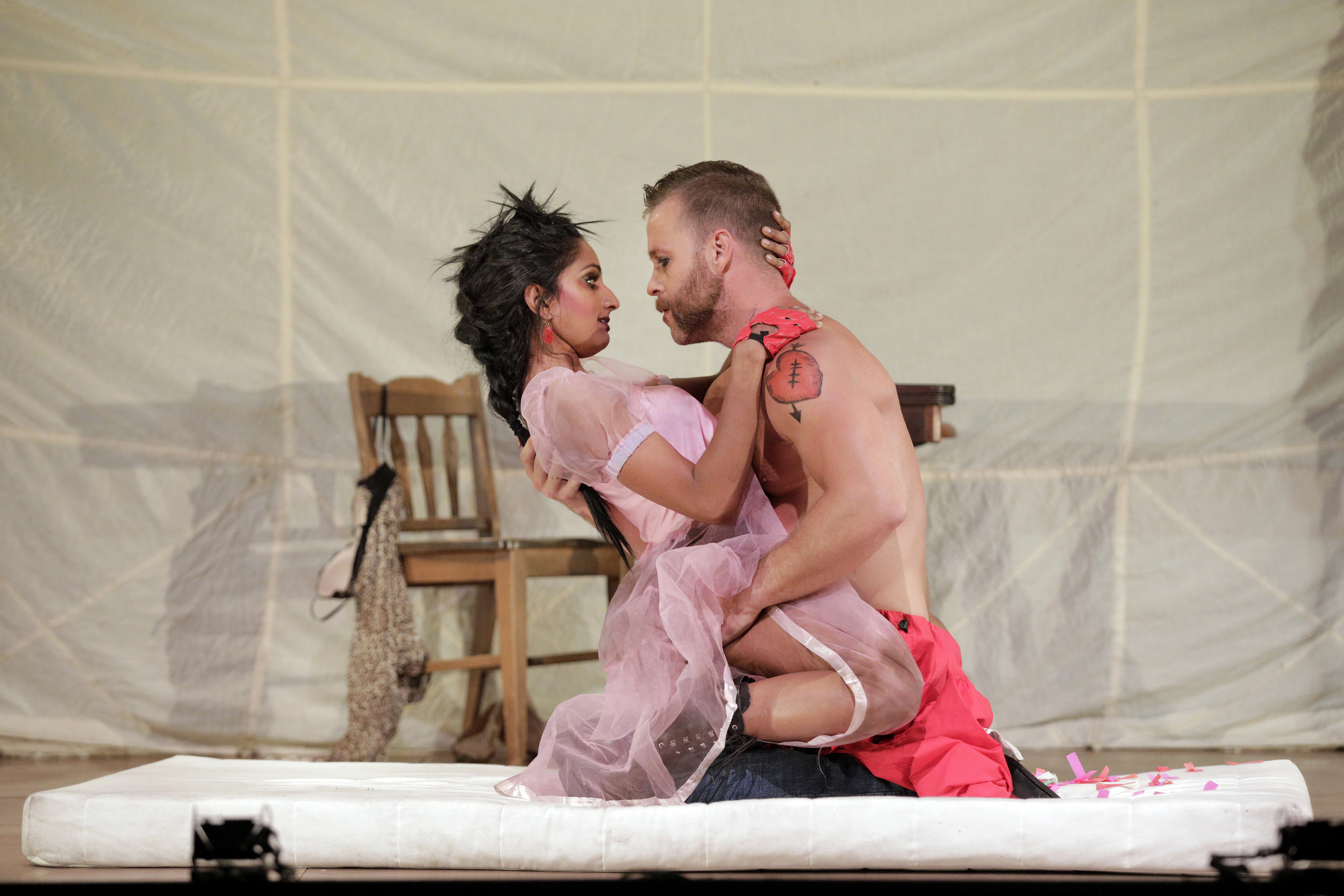 Polly Peachum (Maya Kherani) and Macheath (Derek Chester) in West Edge Opera's production of The Threepenny Opera
