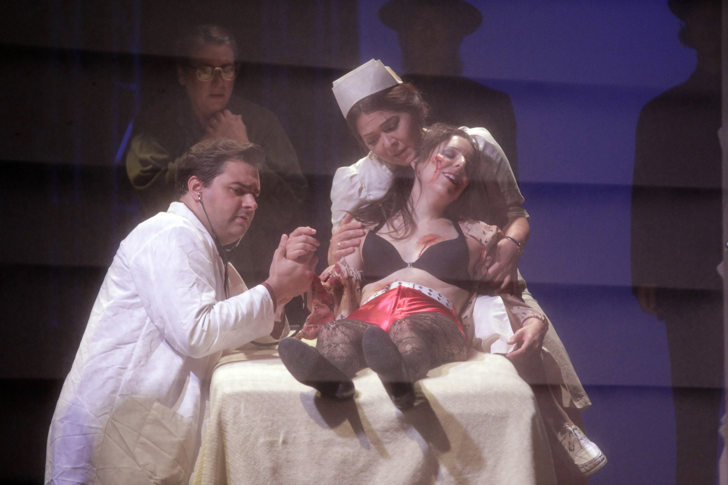 Bess McNeill (Sara LeMesh), Dodo McNeill (Kindra Scharich) and Dr. Richardson (Alex Boyer) in West Edge Opera's production of Breaking the Waves