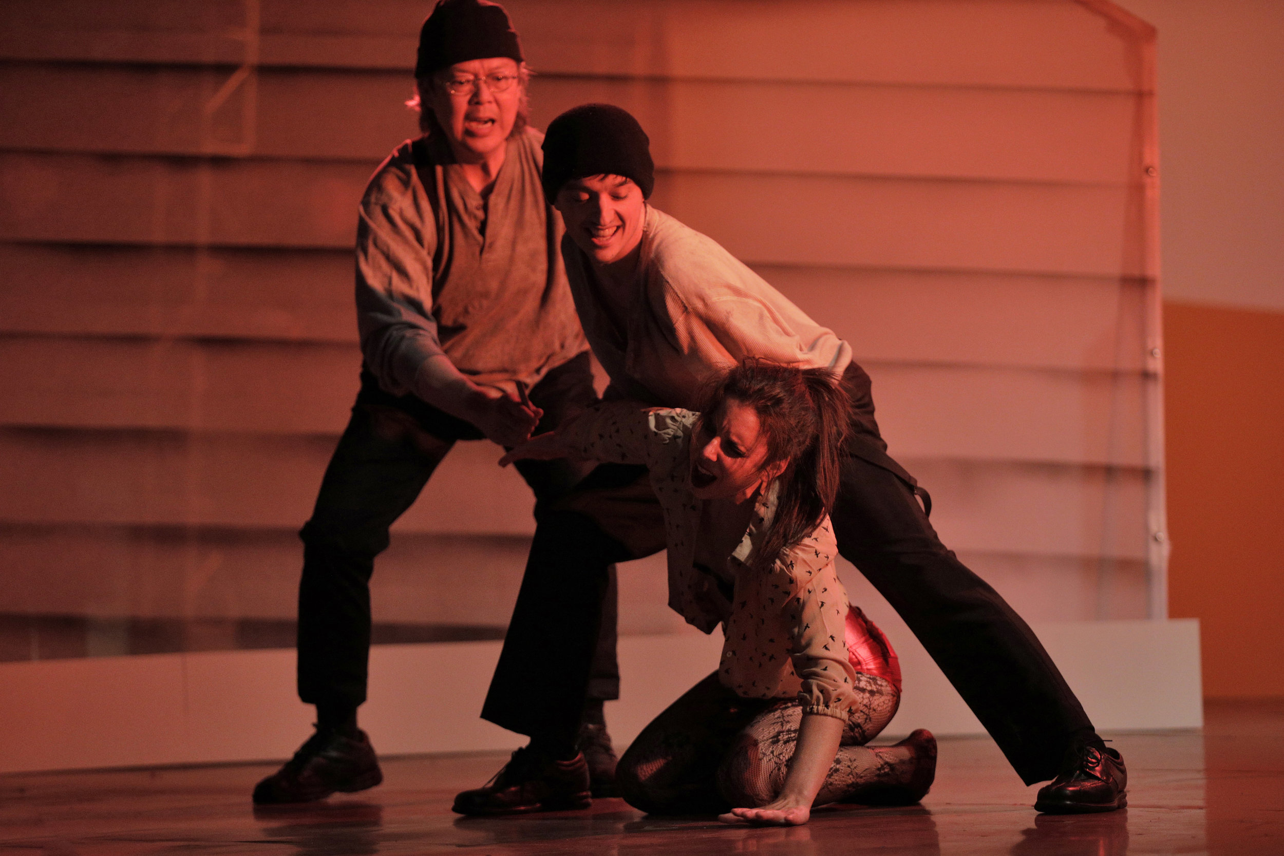 Bess McNeill (Sara LeMesh) encounters two sailors (Chung-Wai Soong and Andrew Green) in West Edge Opera's production of Breaking the Waves