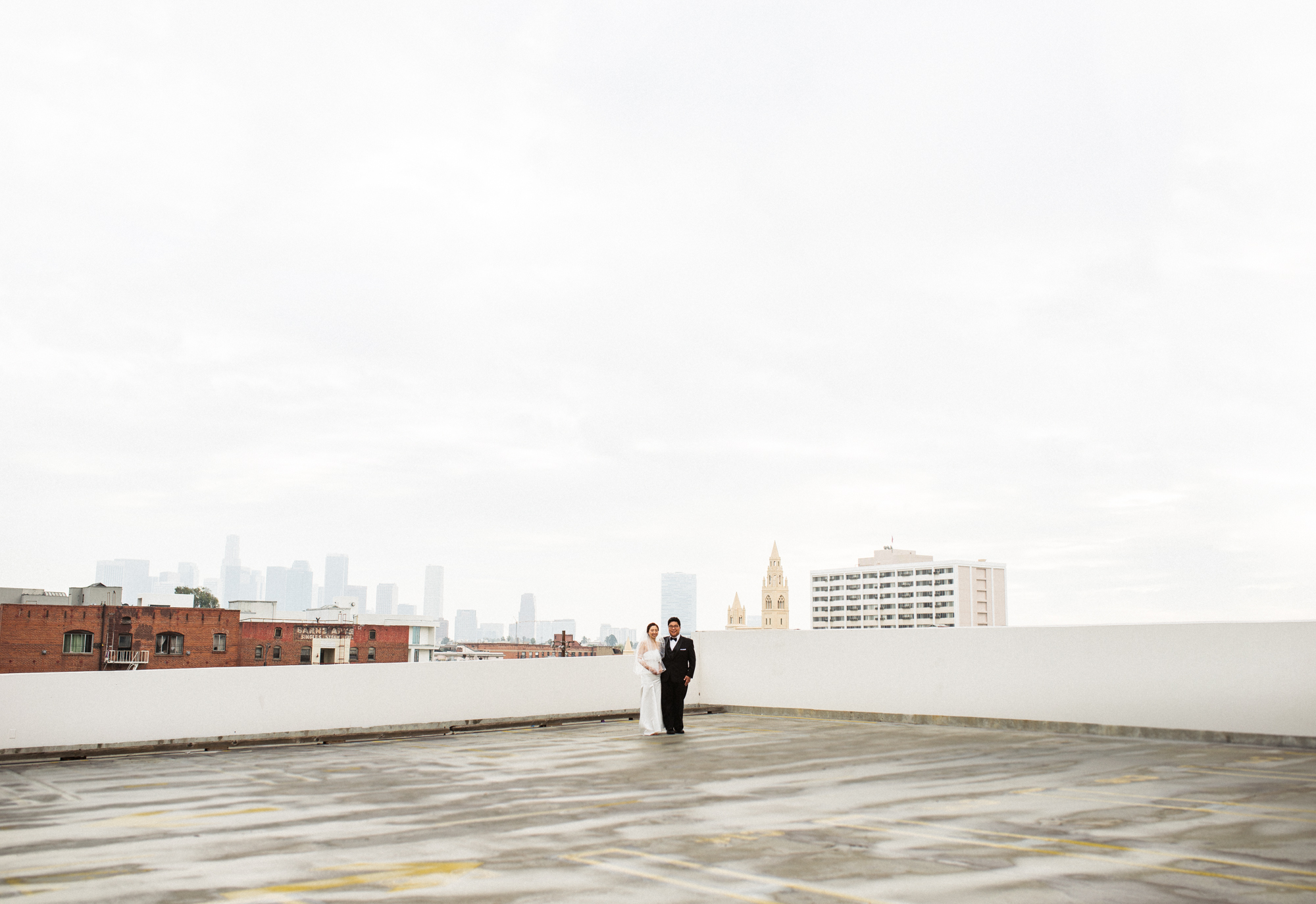 ©Isaiah & Taylor Photography - Destination Wedding Photographers - Downtown Los Angeles Parking Lot Rooftop Wedding-017.jpg