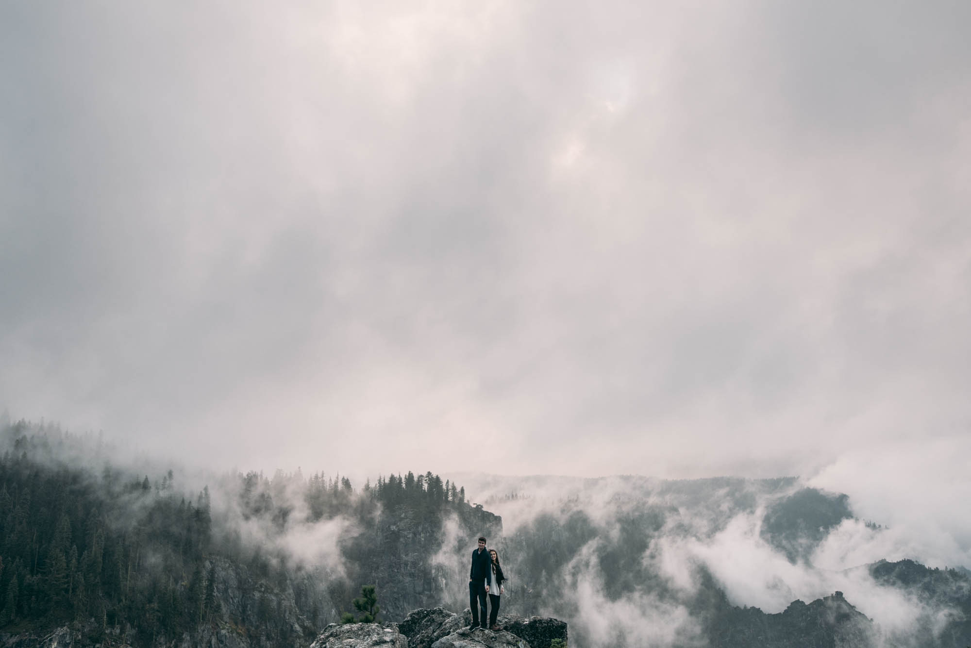 ©Isaiah & Taylor Photography - Stormy Cliffside Engagement, Yosemite California-25.jpg