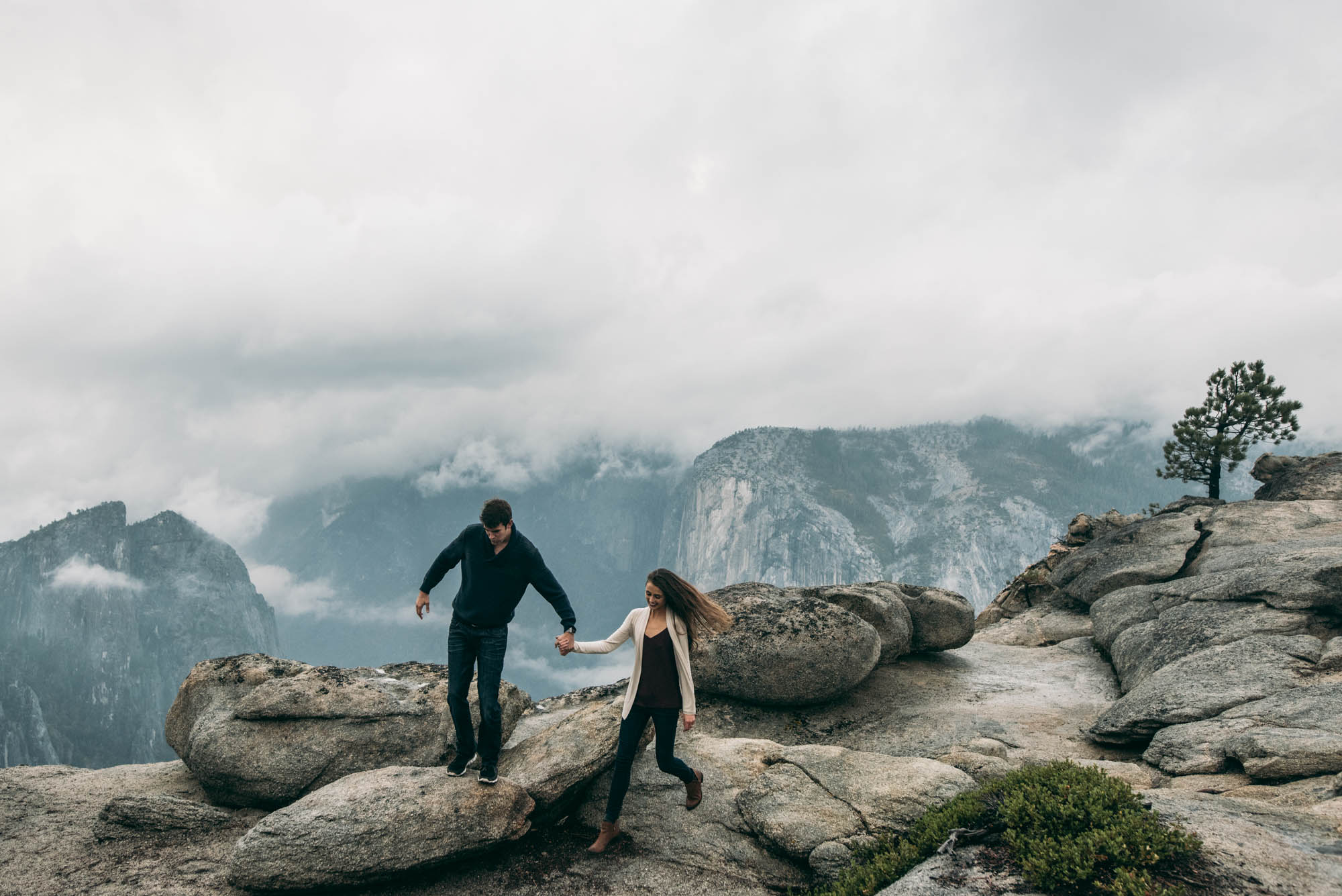 ©Isaiah & Taylor Photography - Stormy Cliffside Engagement, Yosemite California-35.jpg