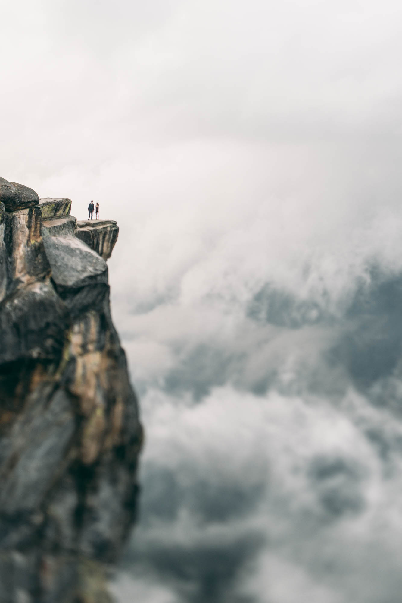 ©Isaiah & Taylor Photography - Stormy Cliffside Engagement, Yosemite California-43.jpg