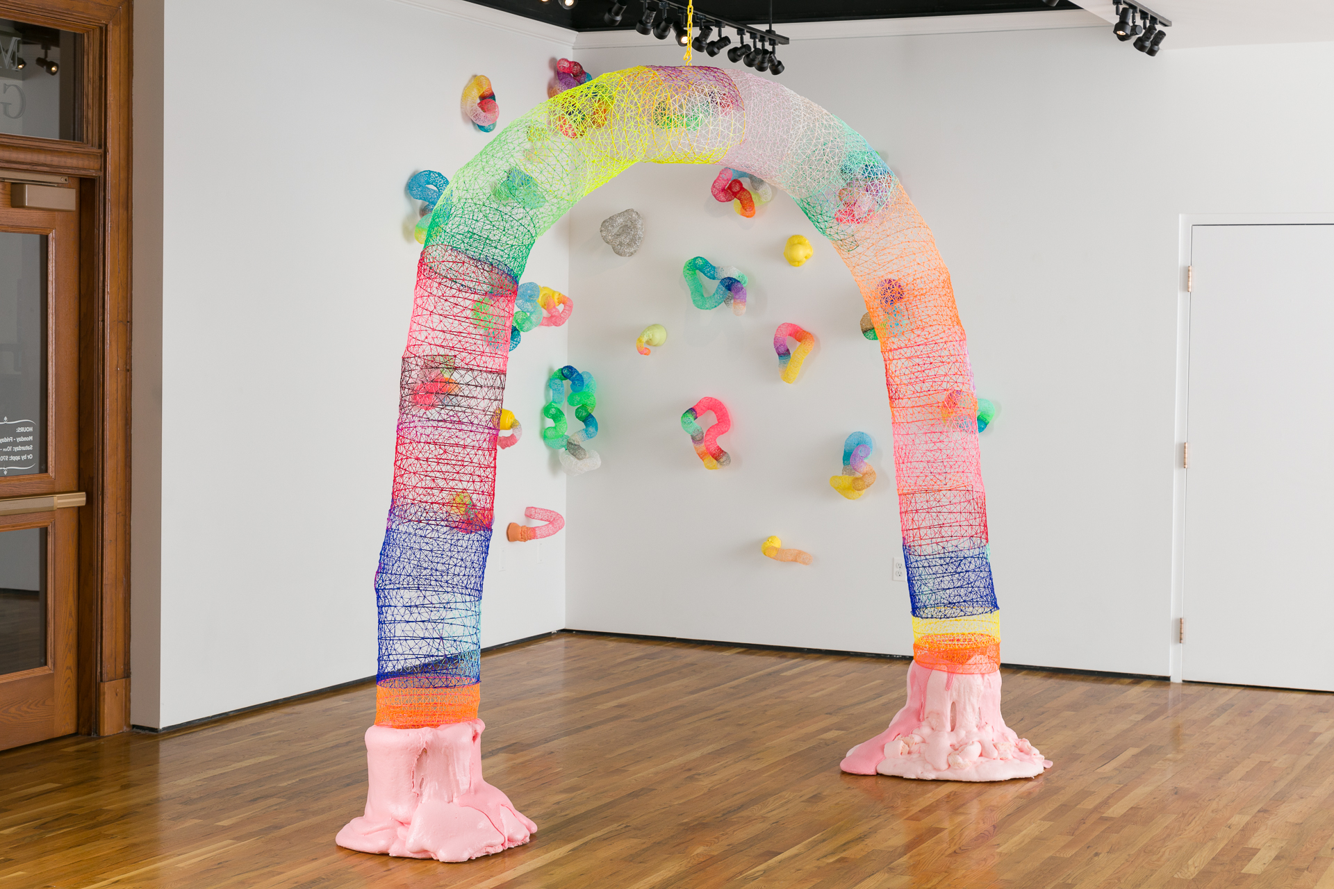 """'Large Arch' 2018, 120"""" x 120"""" x 15"""" ABS Plastic Filament, made with '3d' pen, Flex-Foam, Pigment  'Large Arch' (pictured with 'Climbing Wall' in the background), as part of my solo exhibition 'Super Synthetic' at Mariani Gallery, UNC Greeley 2018. The exhibition connecting plastic, playful tactility, with the hand-made and high-tech reminiscent of a playground."""