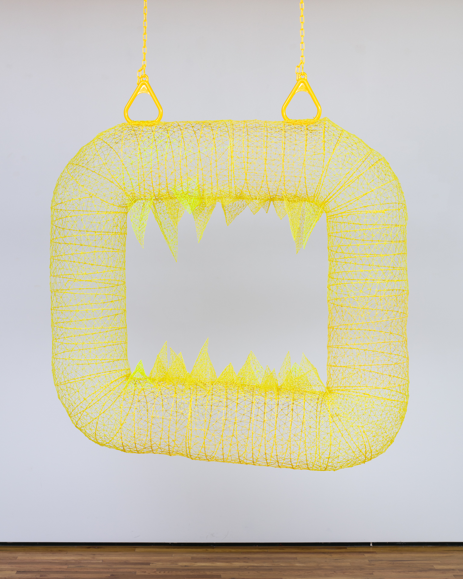 """'Safety Yellow Hellmouth' 2018, 48"""" x 48"""" x 13"""" ABS Plastic Filament, made by '3d' pen, Playground Hardware.  'Safety Yellow Hellmouth' plays on childhood monsters, temptation to touch, and makes an irresistible frame for a 'selfie'. As part of my solo exhibition 'Super Synthetic' at Mariani Gallery, UNC Greeley 2018."""