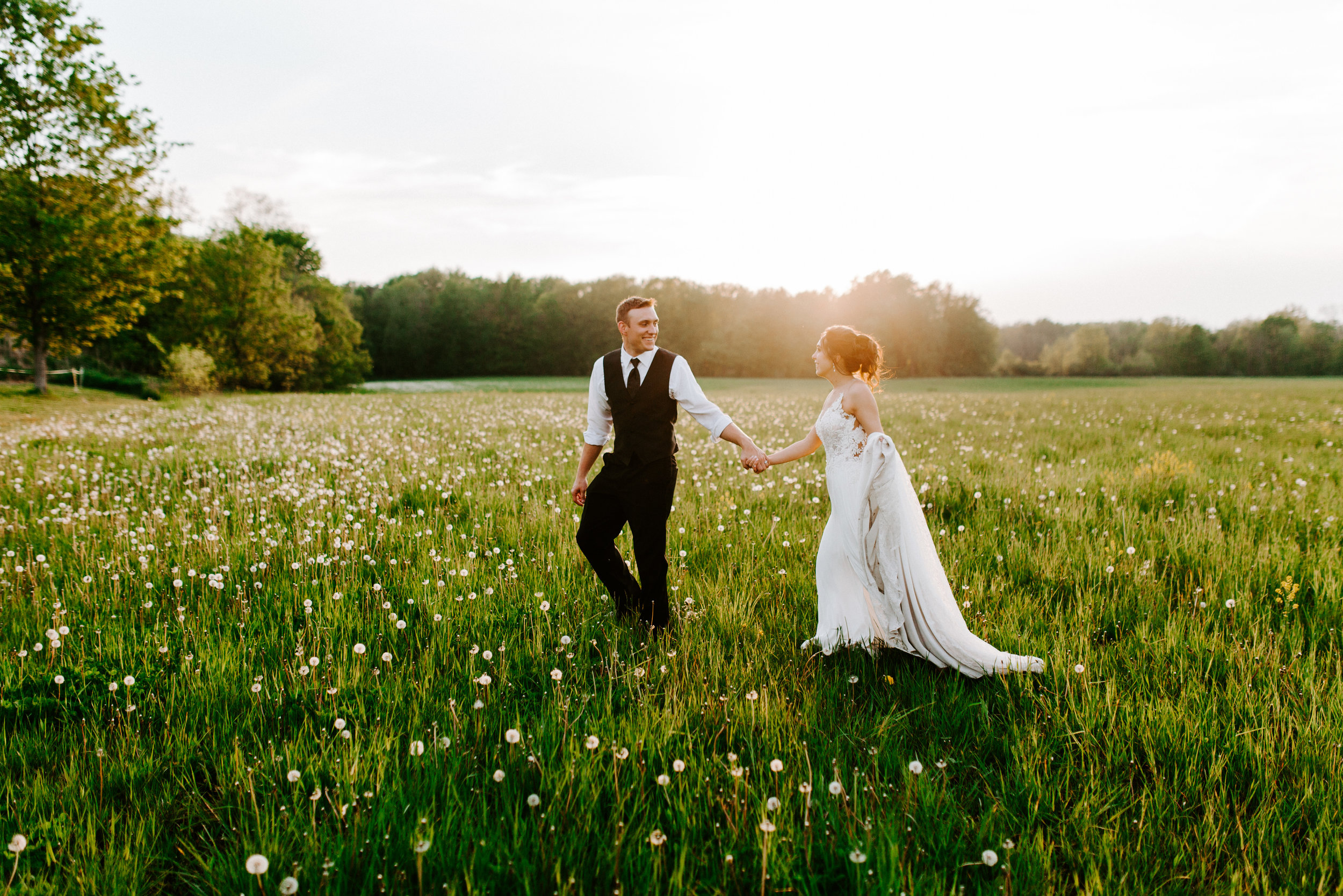 An Irish Hills wedding in Southern Michigan full of charm, Ray and MacKenzie's wedding included a unique stop to the Michigan International Speedway to revisit where the bride and groom first met.