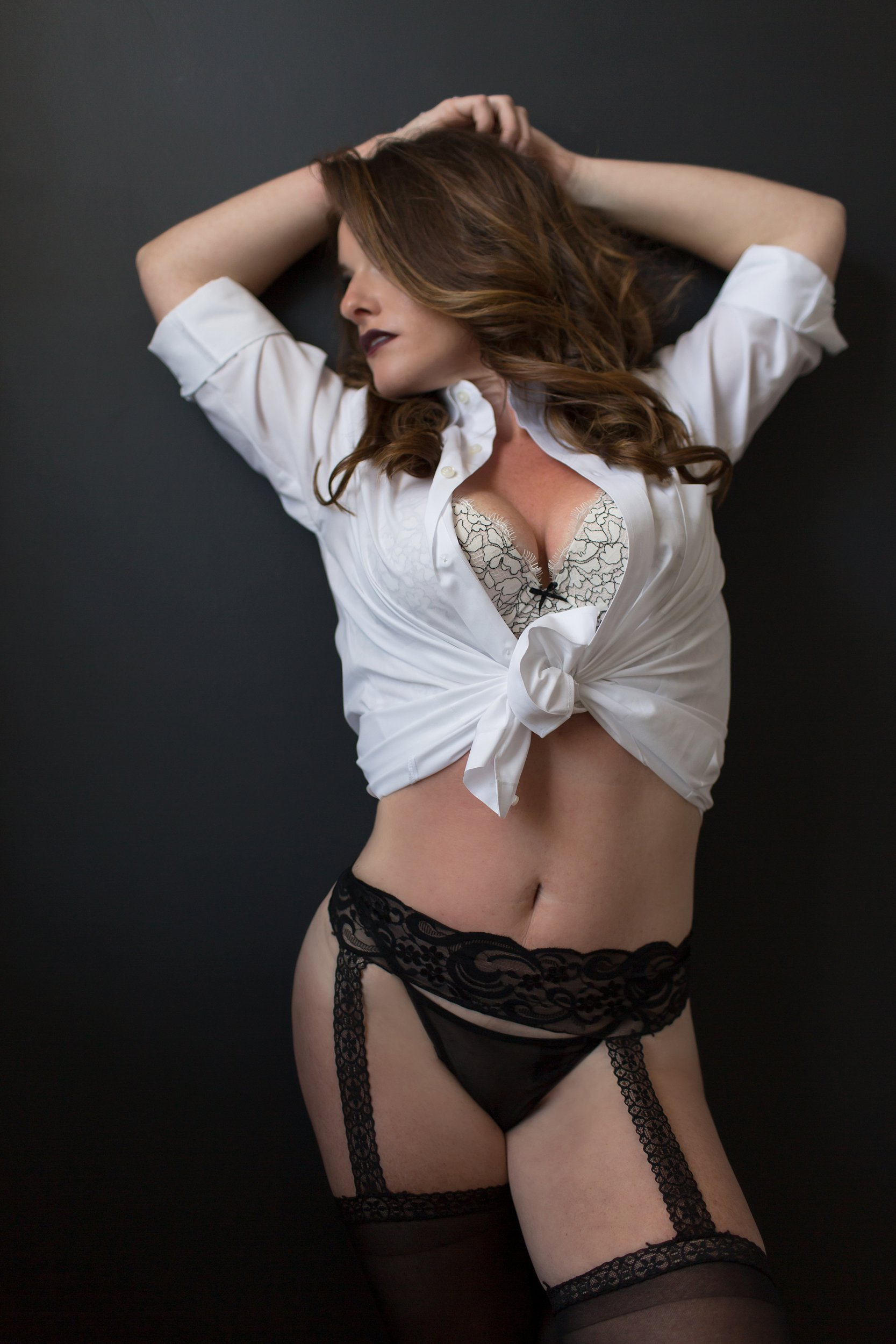 Boudoir in men's dress shirt and garter with stockings