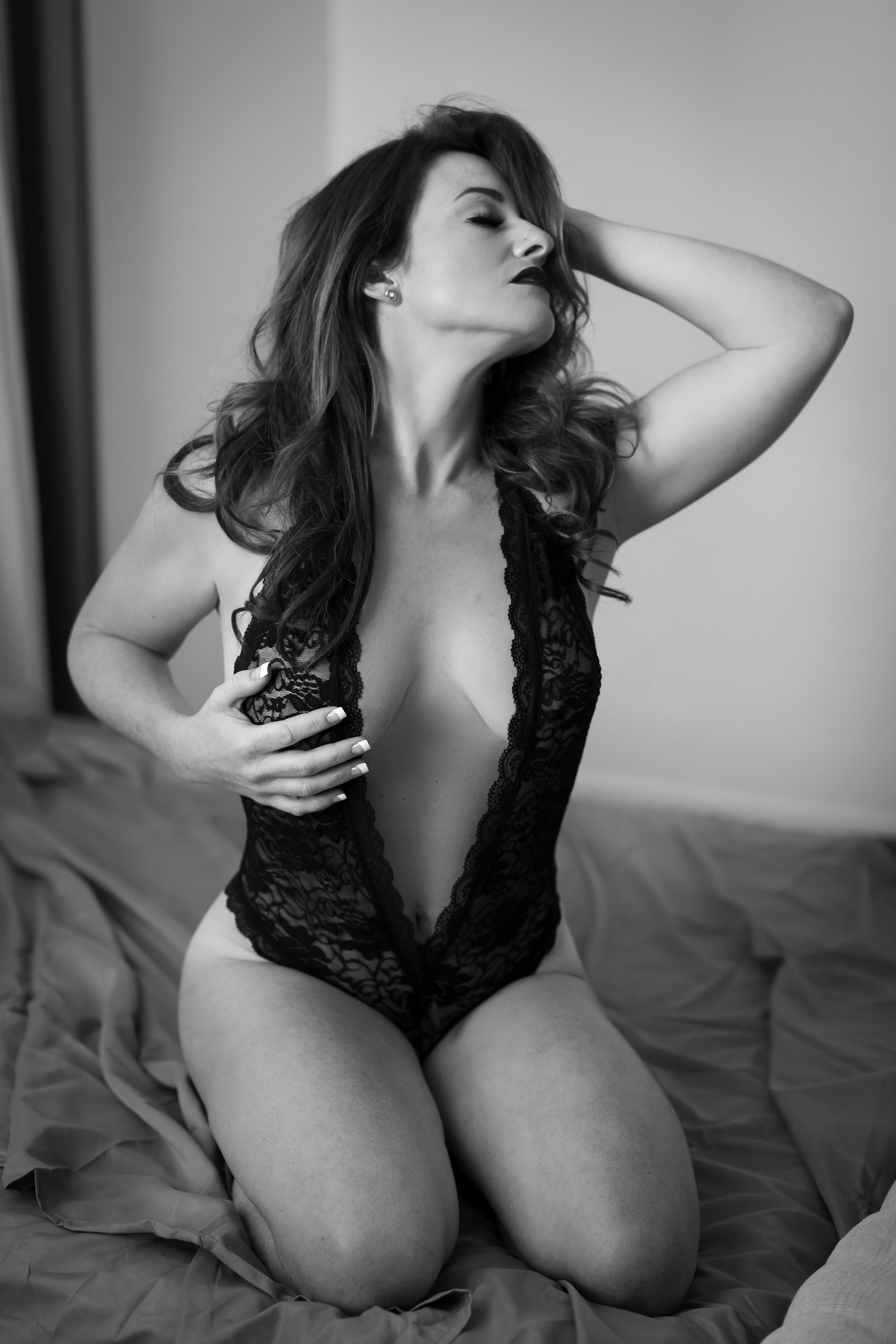 Black and white photo of woman in lace teddy