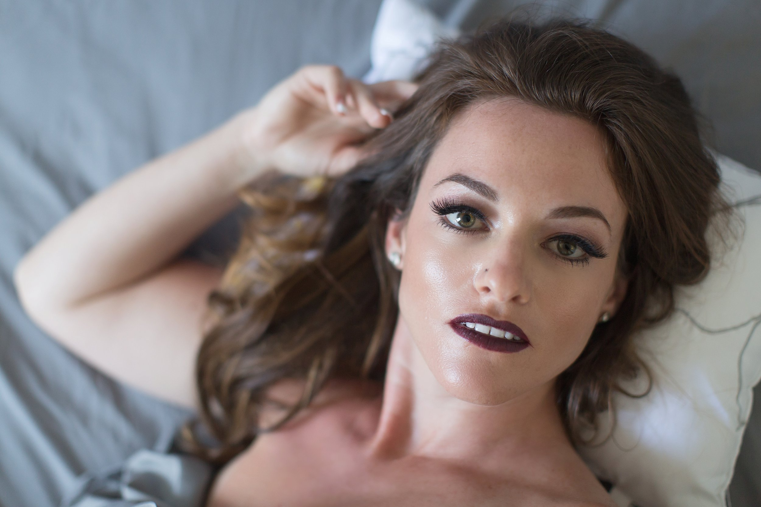 Woman with beautiful dramatic makeup and dark lips