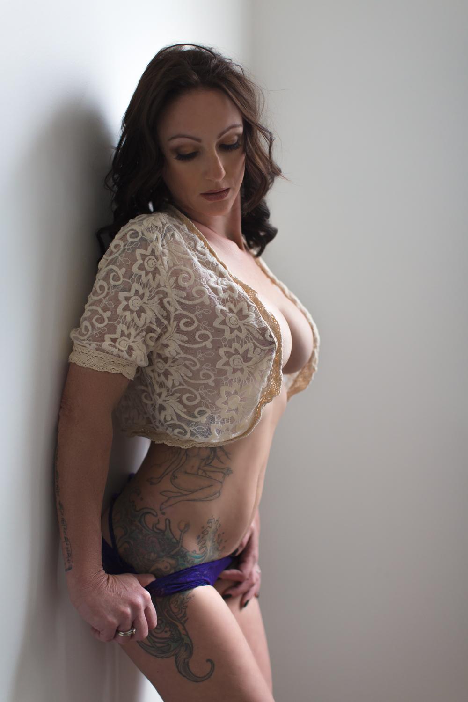 Mermaid side tattoo, sexy boudoir wall pose