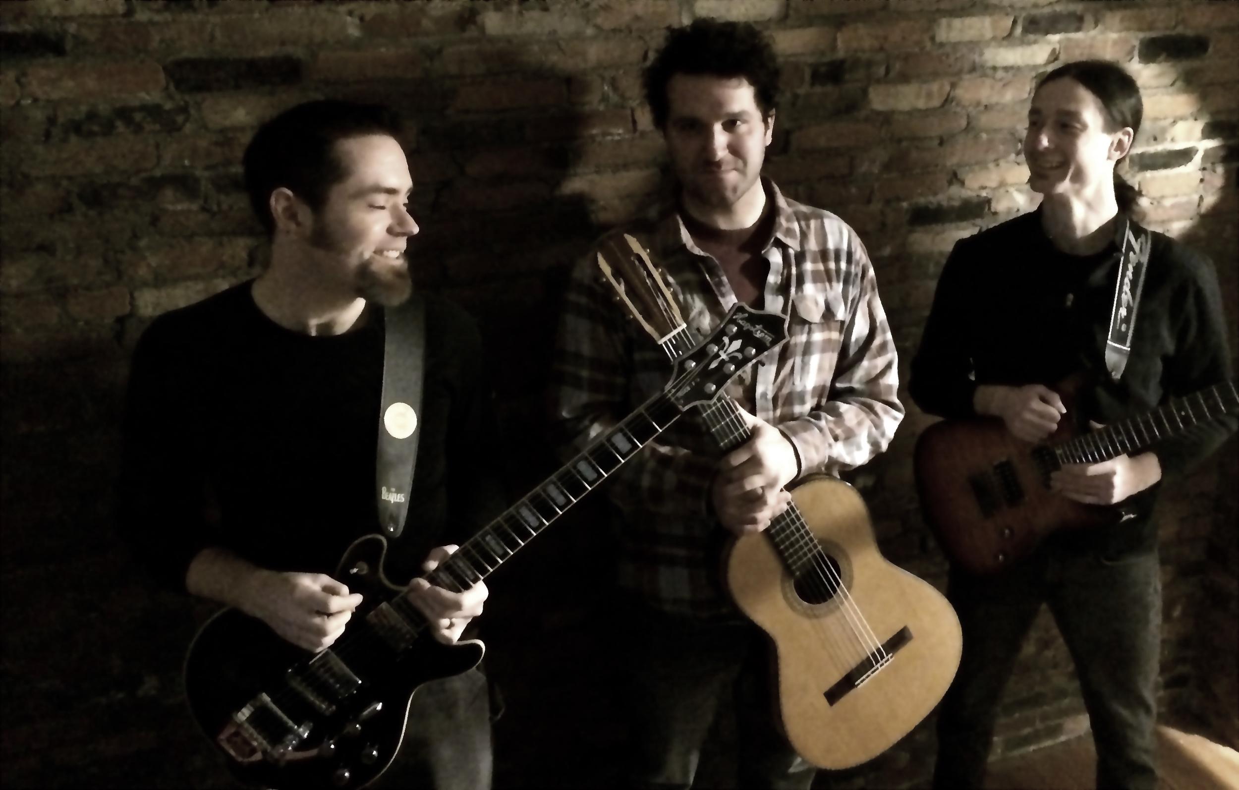 with  Elm City guitar instructors Geoff Williams and Kurt Daniels