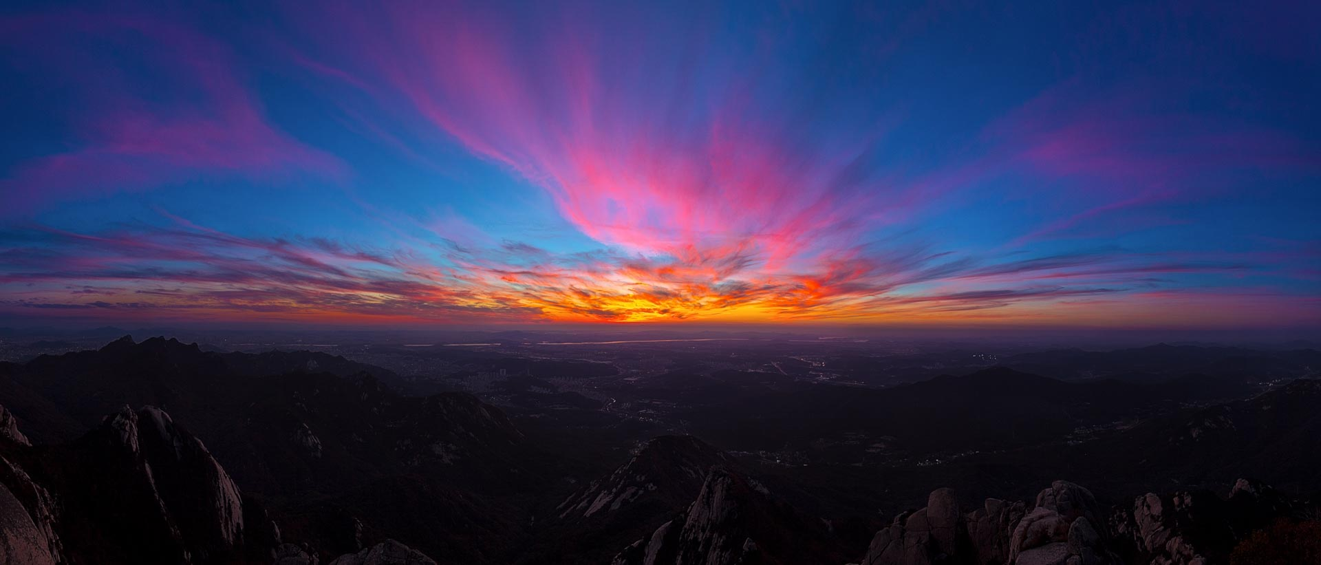 Sunset from Baegundae Peak atop Bukhansan Mountain. South Korea.