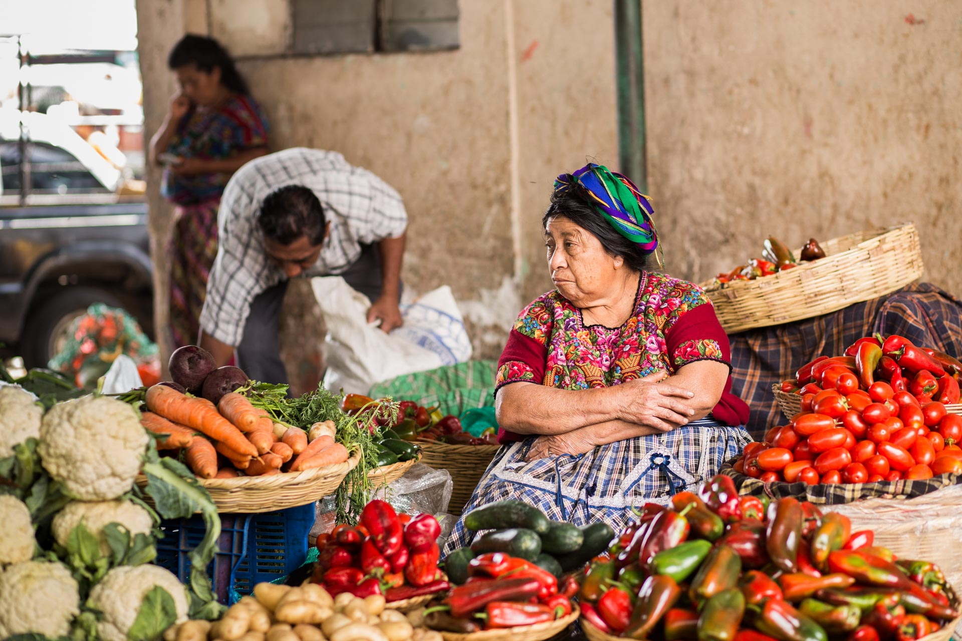 A lady selling fresh vegetables at La Terminal market in Guatemala City.