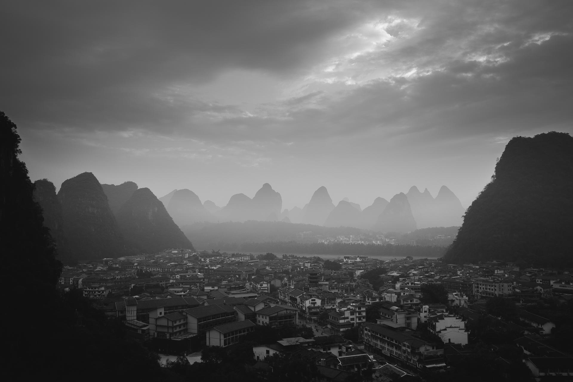 Foggy sunrise over the town of Yangshuo. China