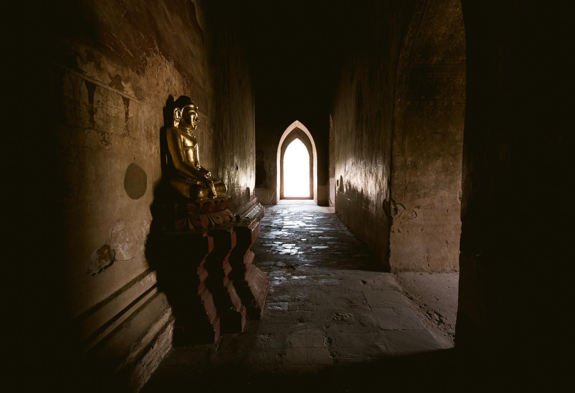 Golden Buddha inside a temple in Bagan. Myanmar