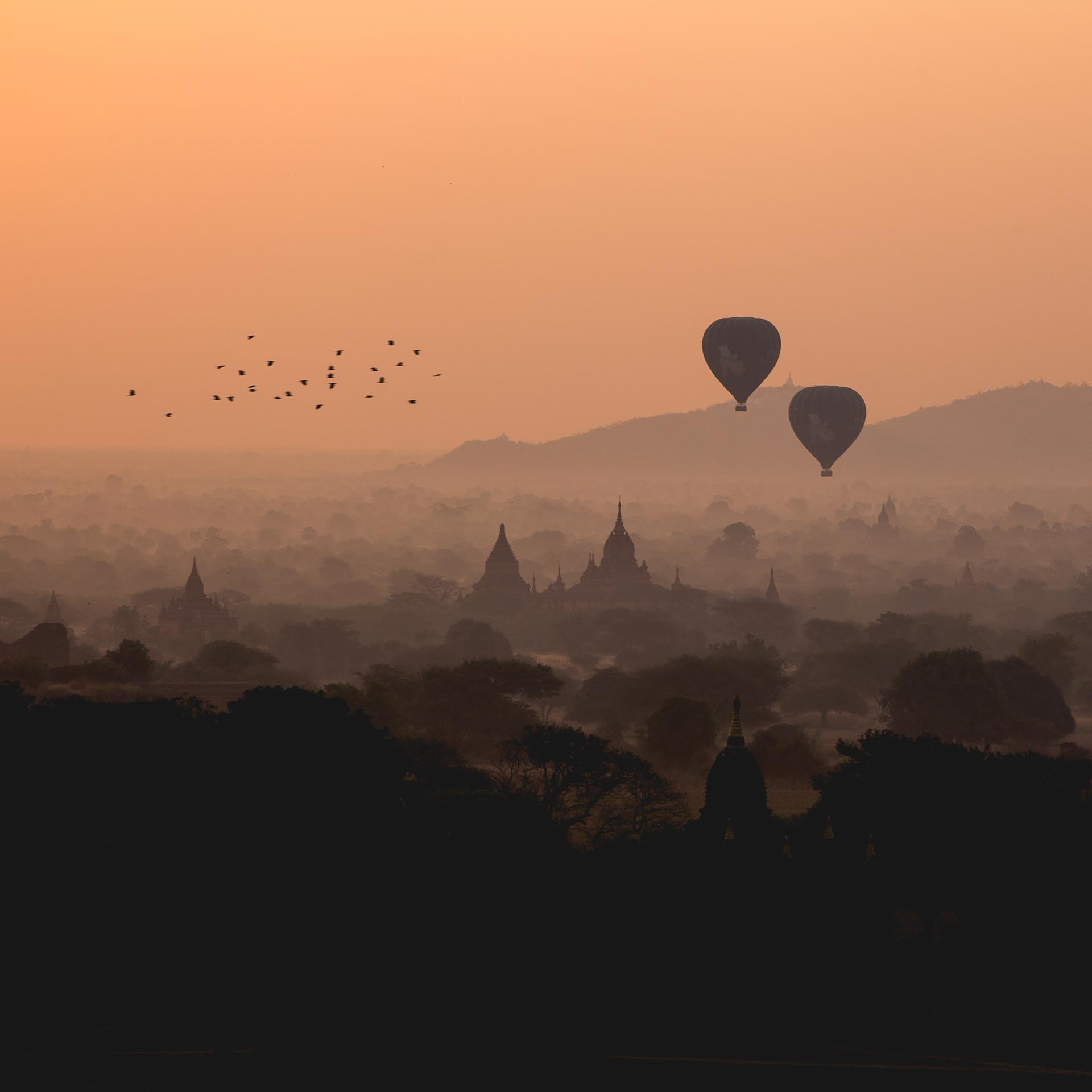 Sunrise and hot air balloons over Bagan. Myanmar