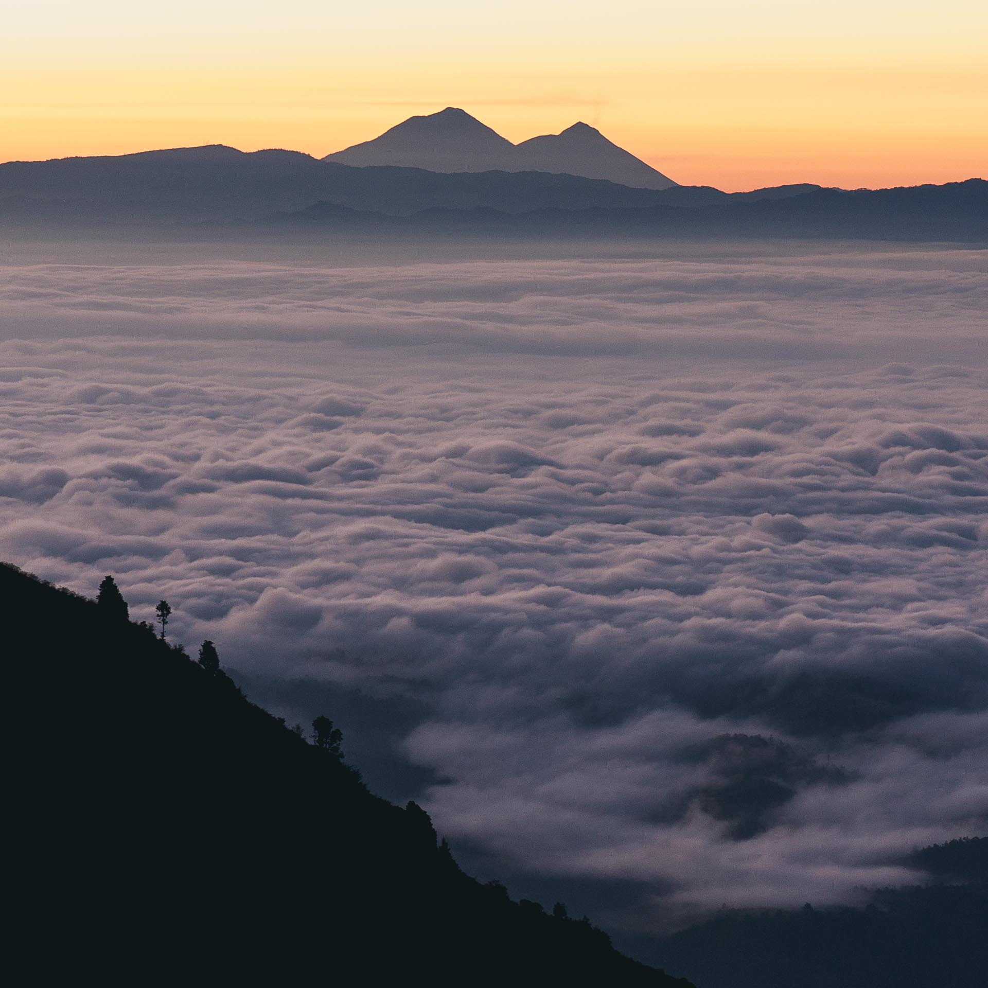 Sunrise overlooking volcanoes from the Cuchumatanes mountain range. Guatemala