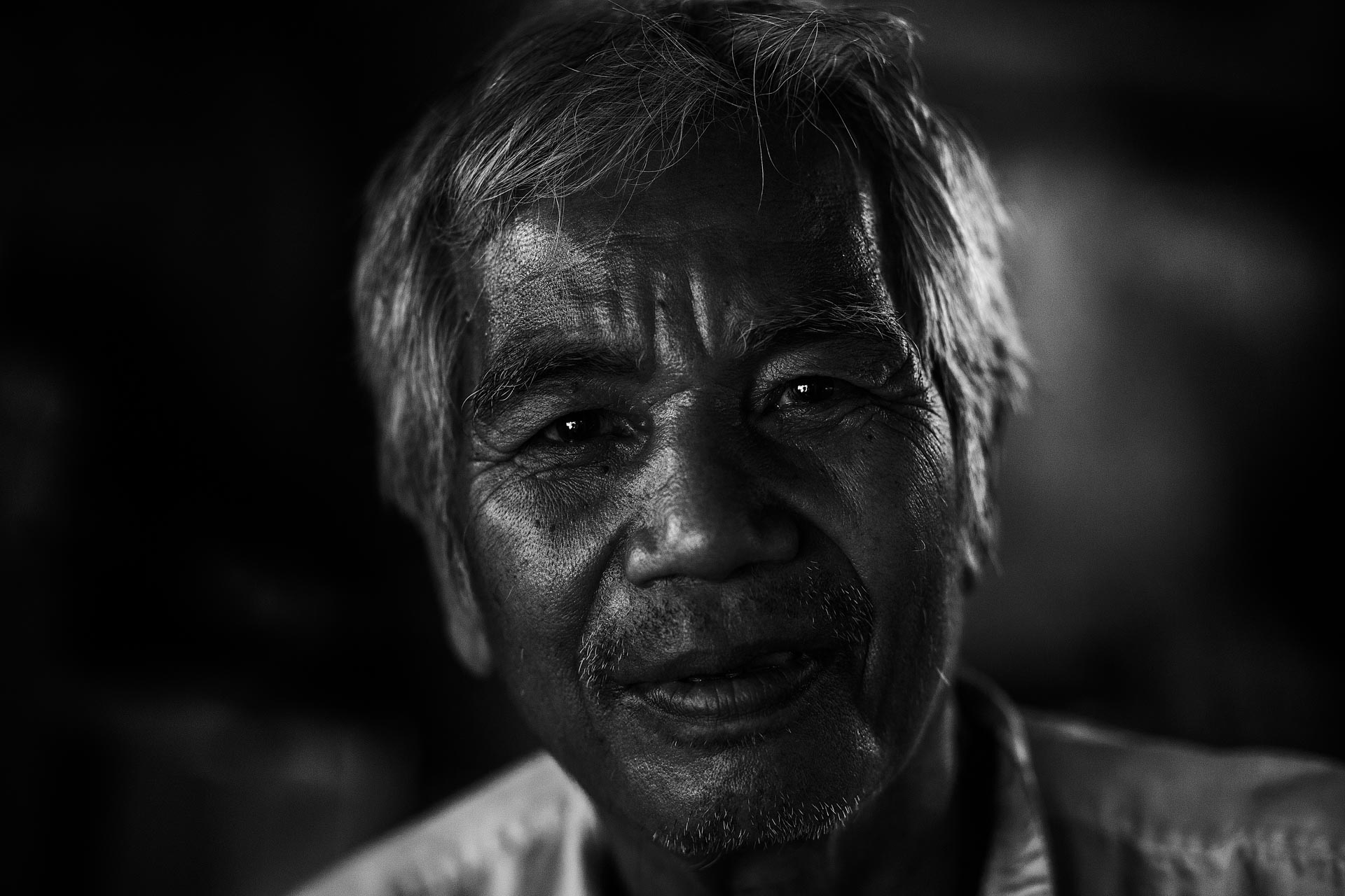 Chin man in his home in a village in Rakhine state. Myanmar