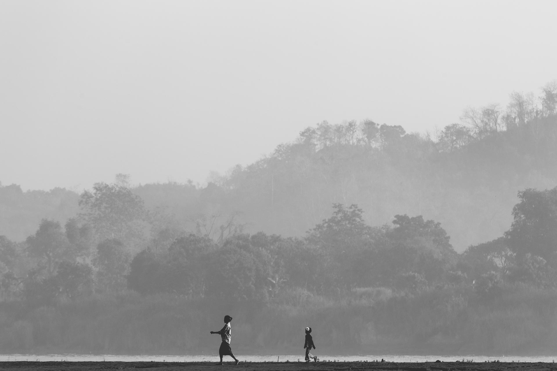 Mother and daughter walking along the Lemro river. Myanmar