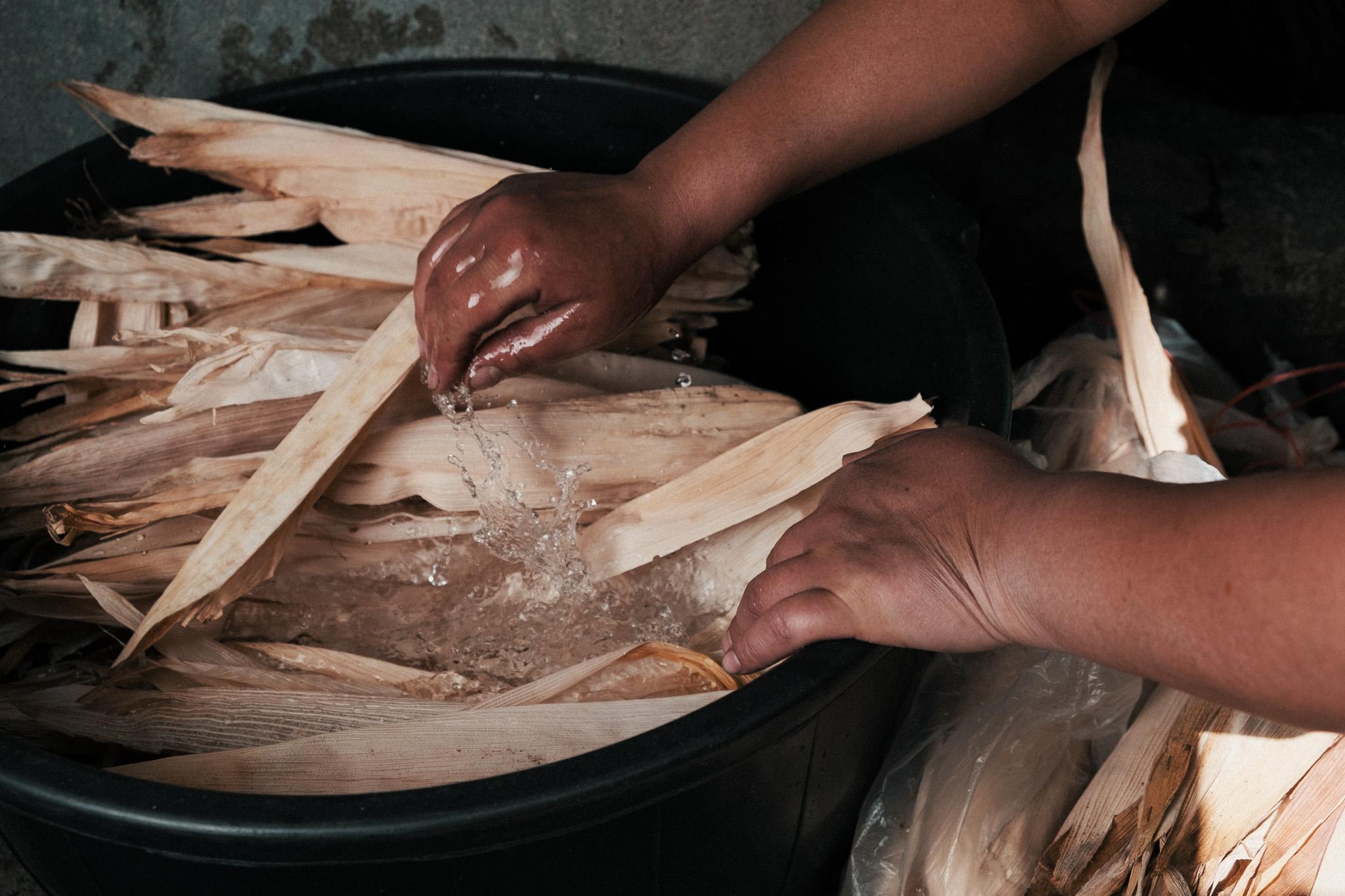 Washing the corn husks for the chuchitos.