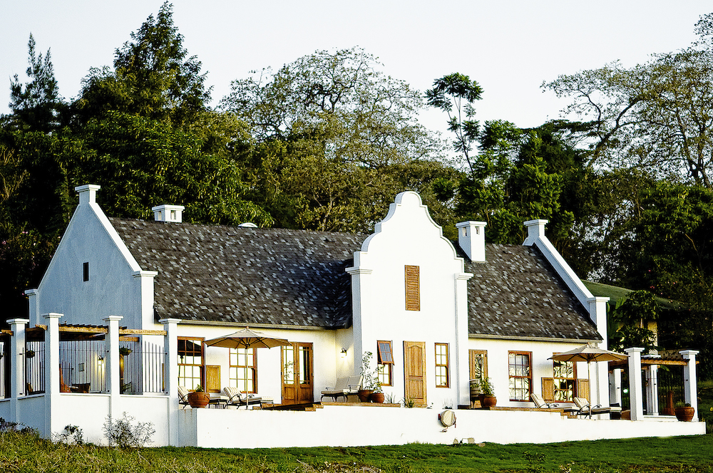 T    he Manor  : A luxurious Cape-Dutch inspired lodge located on a large coffee estate