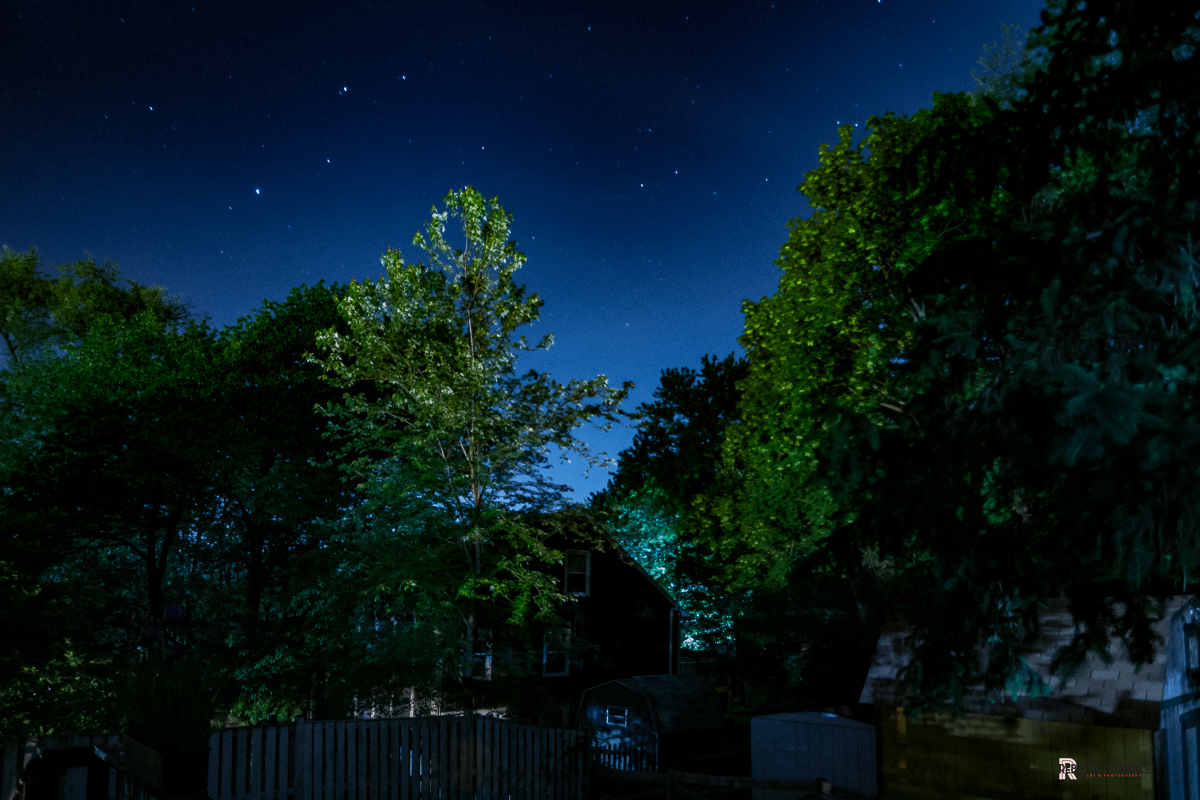 """""""12:00"""" (c) Rebecca LaChance, 2016. Thurmont, MD. The final image of an experiment. It is stunning to see the effect of a single porch light on the night sky."""